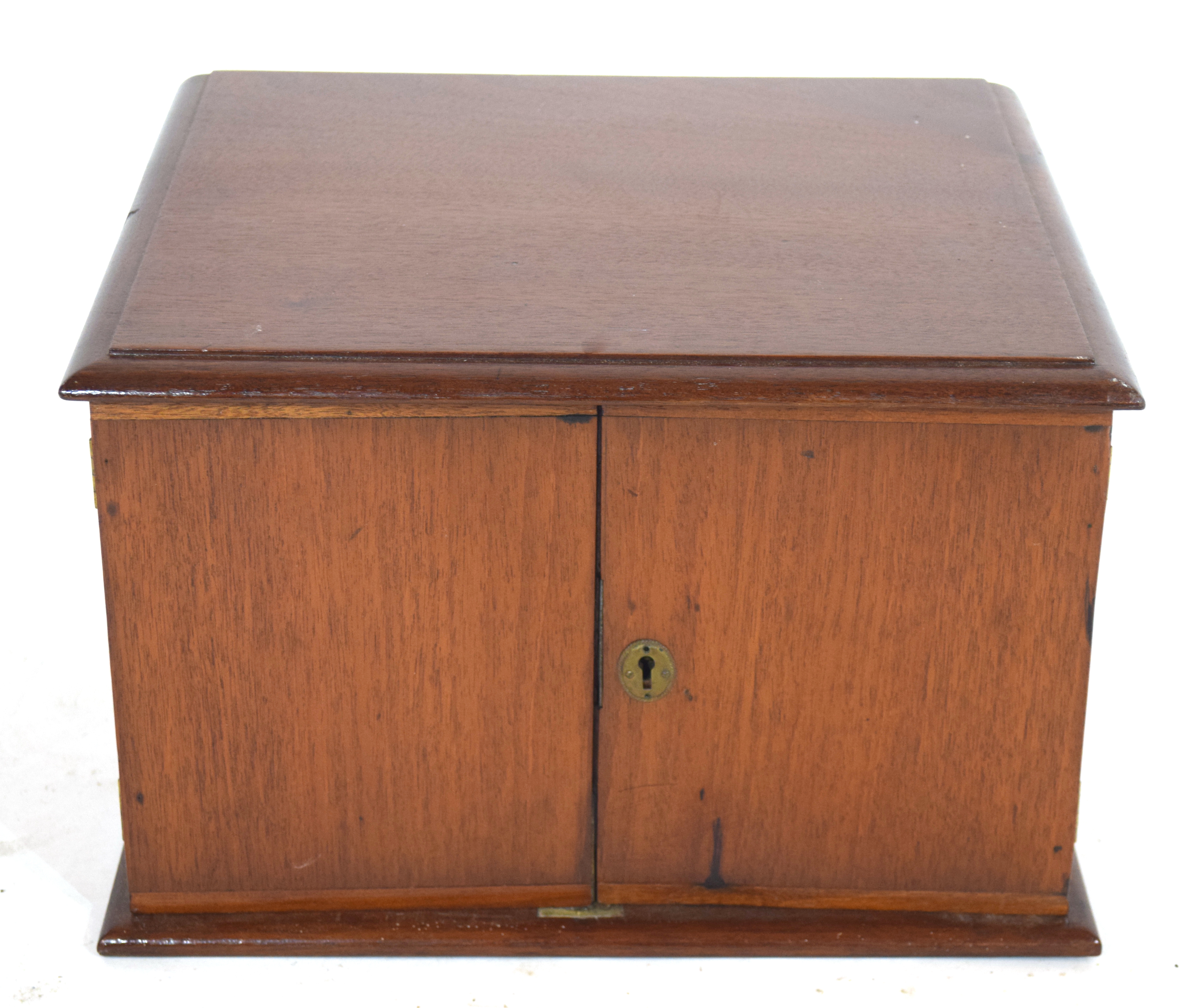 Late 19th/early 20th century hardwood table top cabinet with two doors opening to an interior with