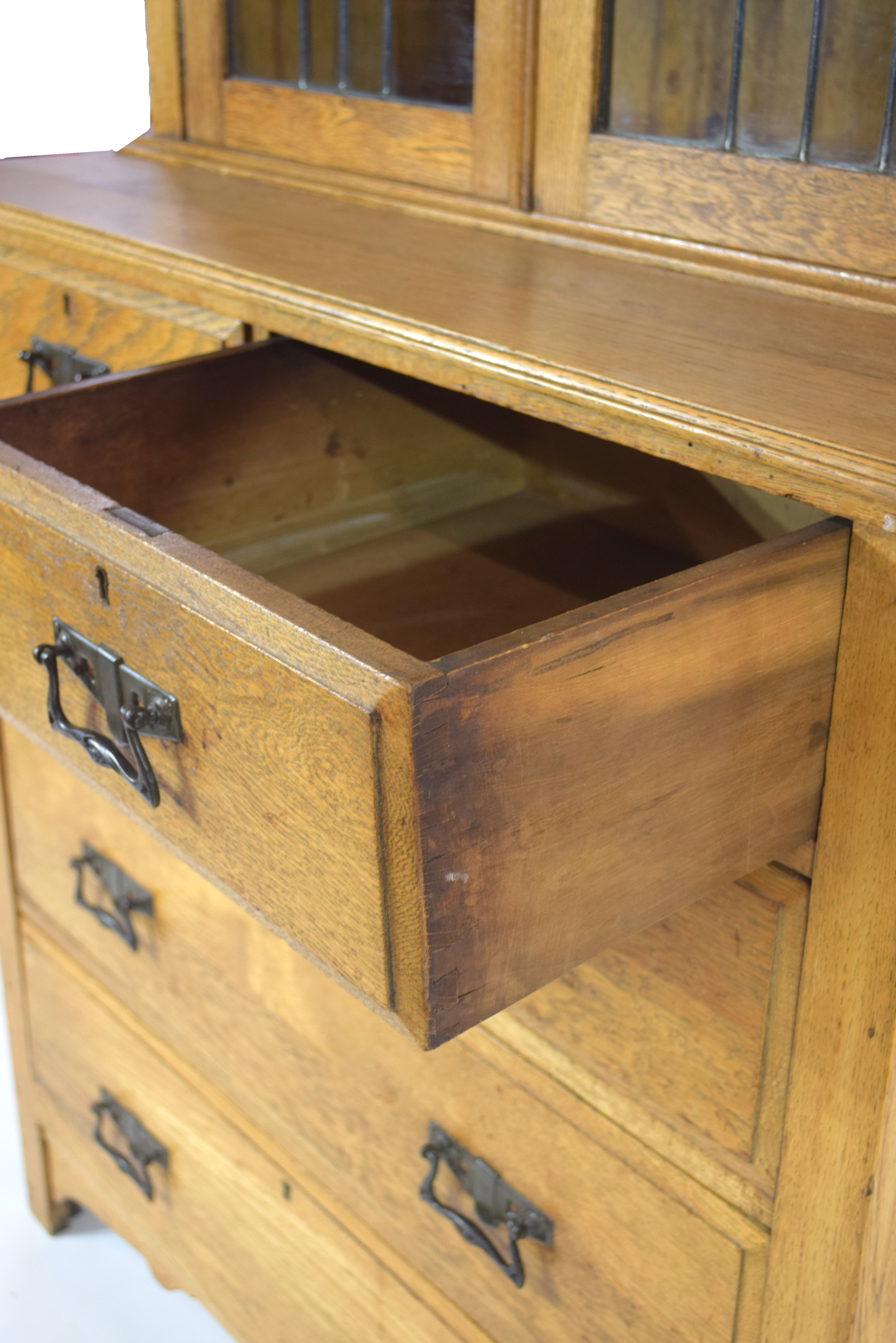 Late 19th century light oak two-piece cabinet, the top section with double glazed doors with Art - Image 3 of 7