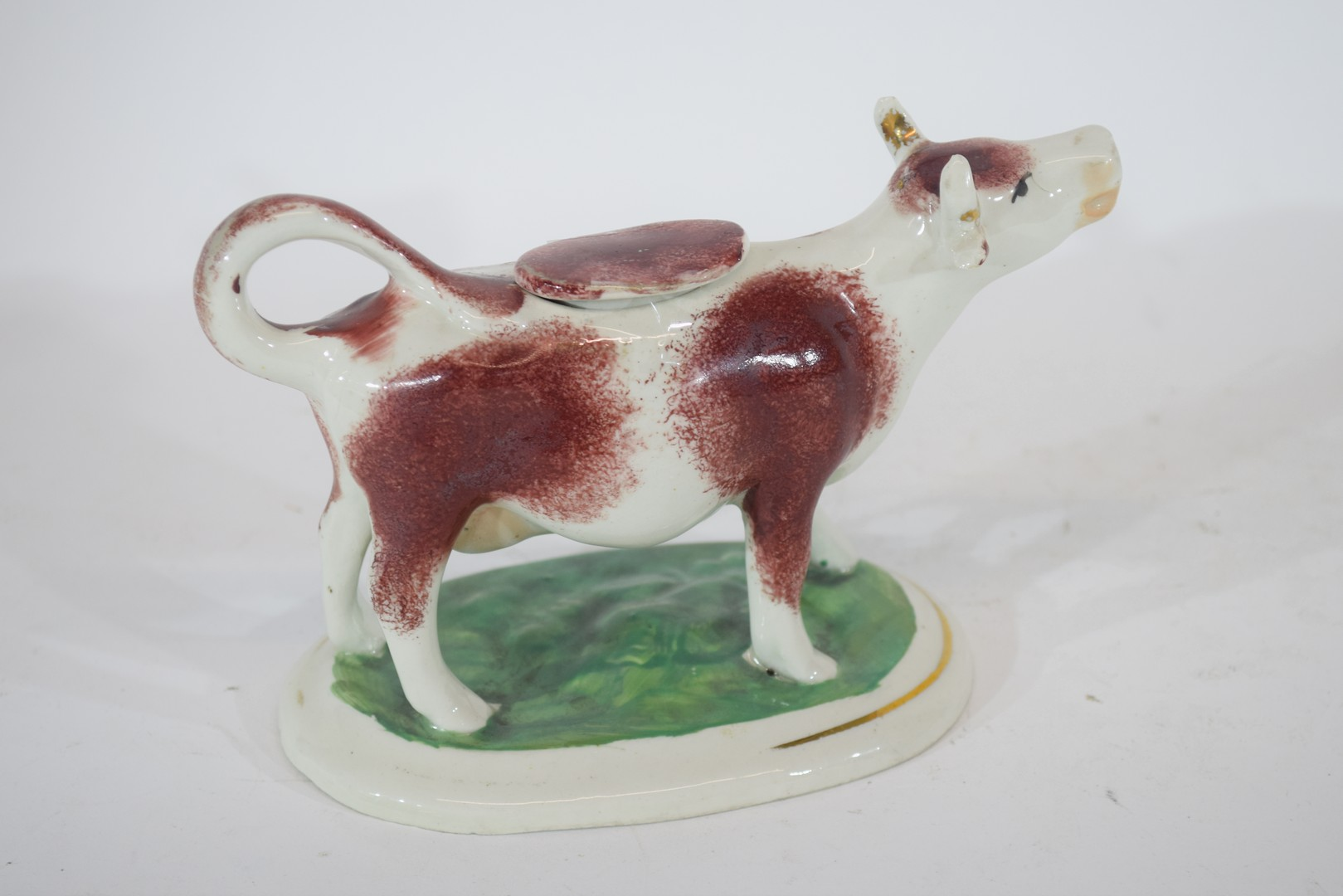 Pottery model of a cow creamer