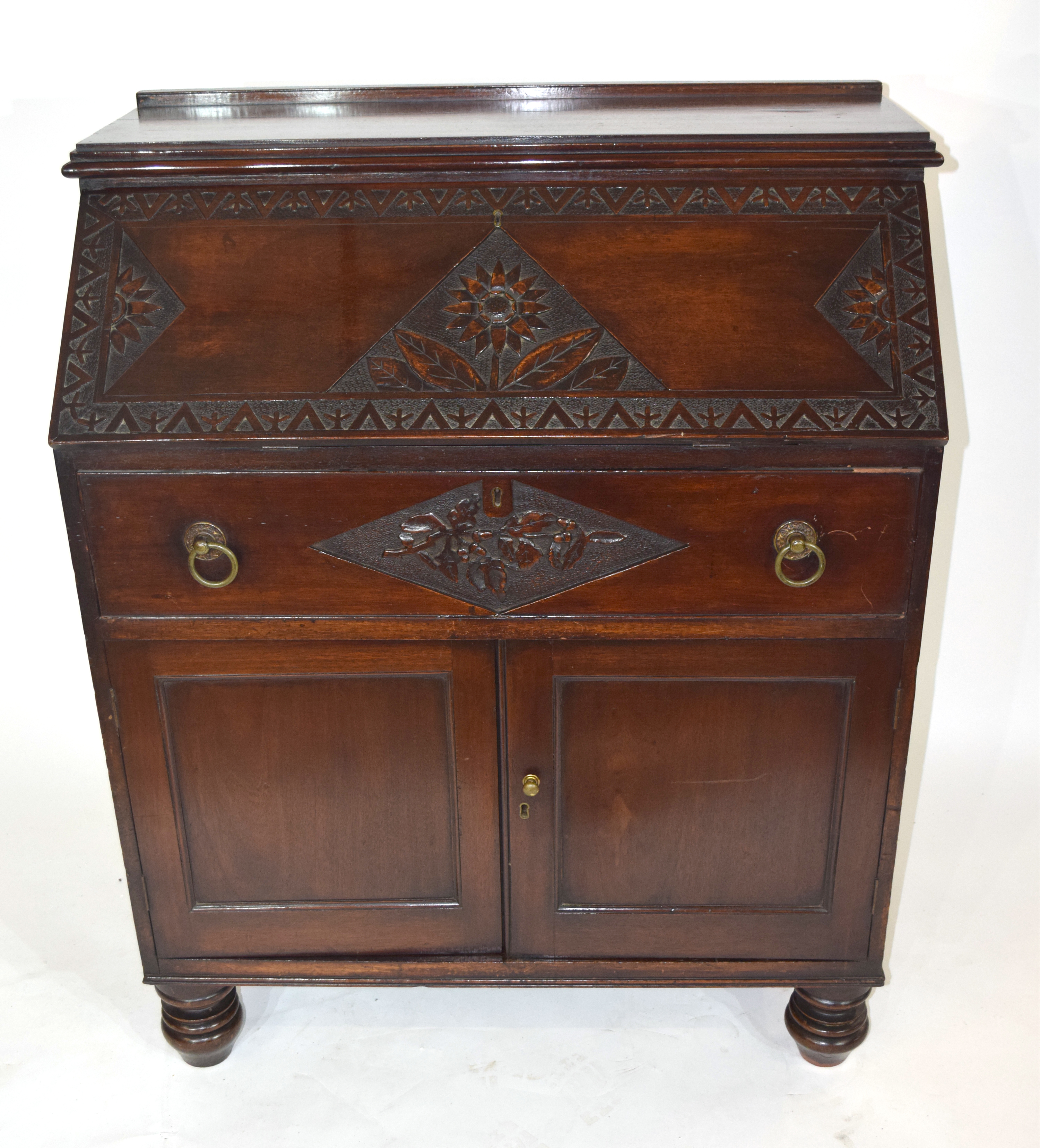 Late 19th/Early 20th century mahogany bureau with full front decorated with carved floral detail