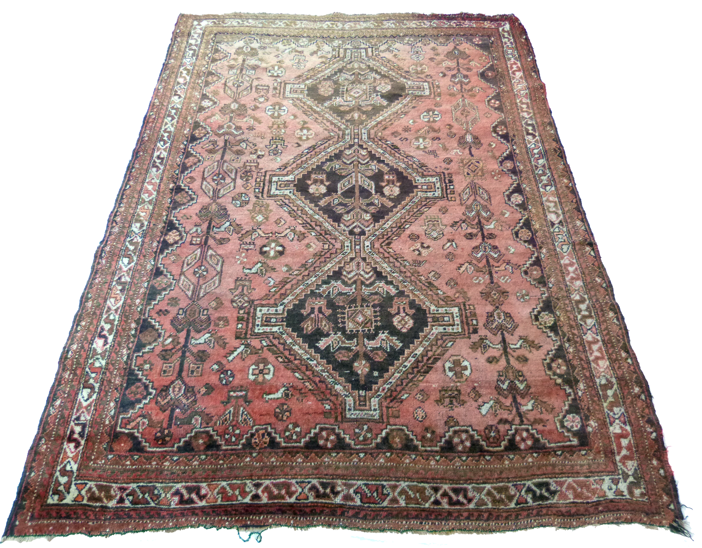 Caucasian wool carpet with three large lozenges to centre, in faded beige, red and pink, 173 x