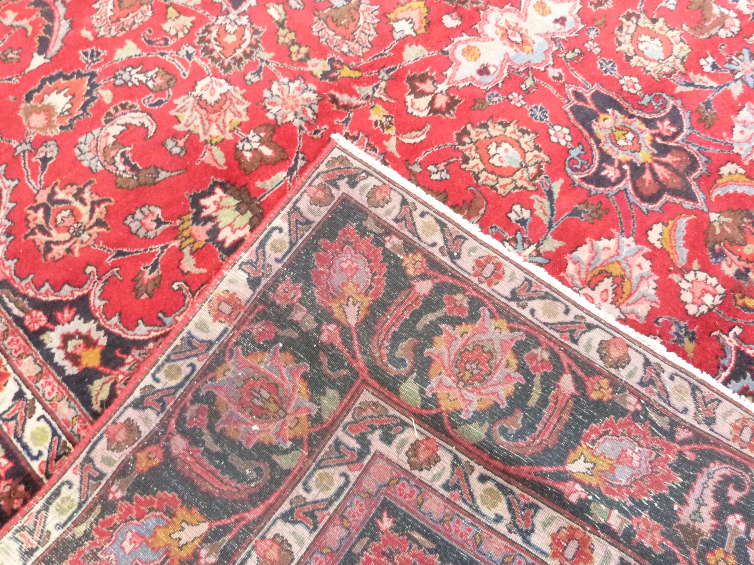 Large red ground Persian Mashad Carpet, mutlicoloured with traditional design 388cm x 270cm approx - Image 6 of 7