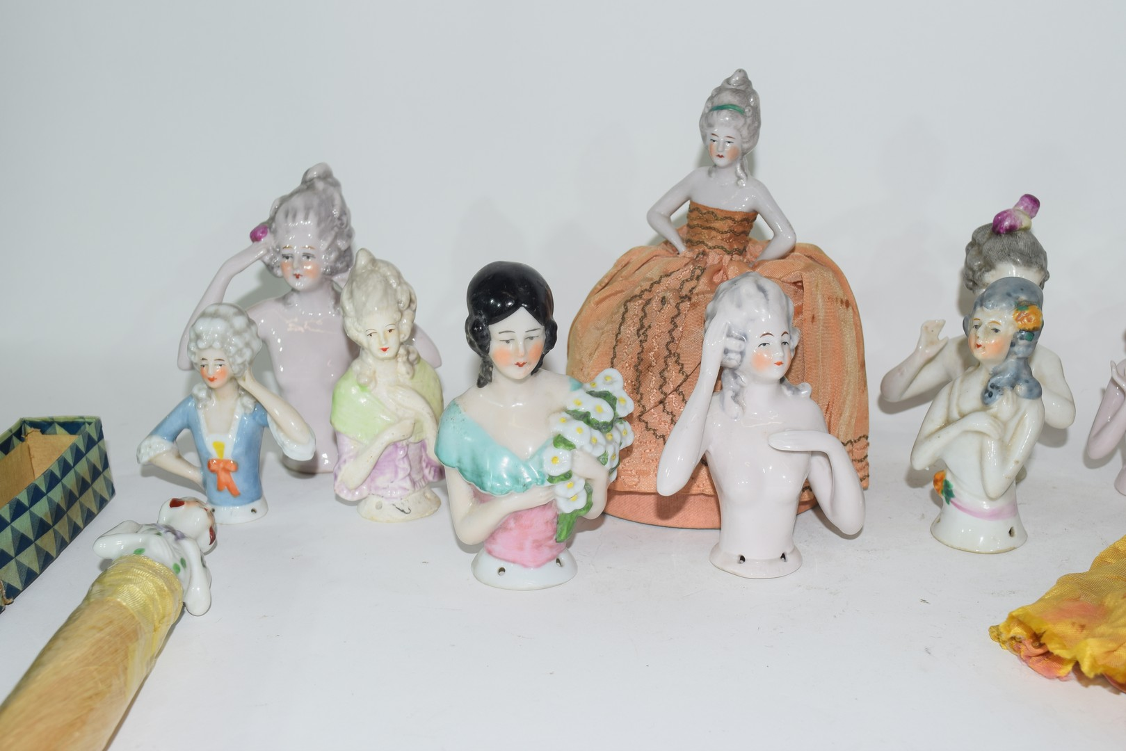 A collection of various continental porcelain pin cushion dolls to include examples in dress, a - Image 3 of 4