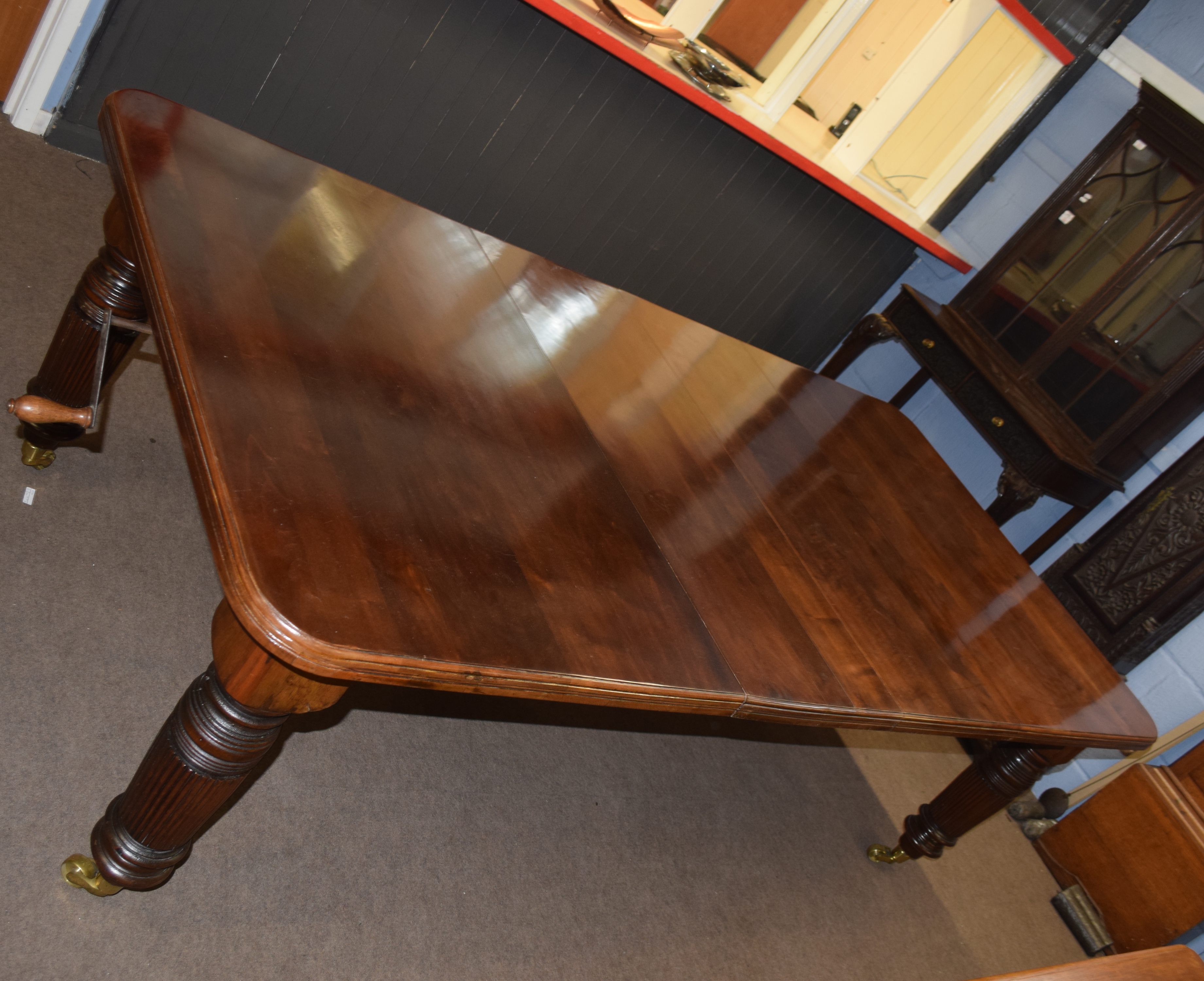 Late Victorian mahogany extending dining table raised on fluted legs and brass casters, 237cm wide - Image 3 of 6