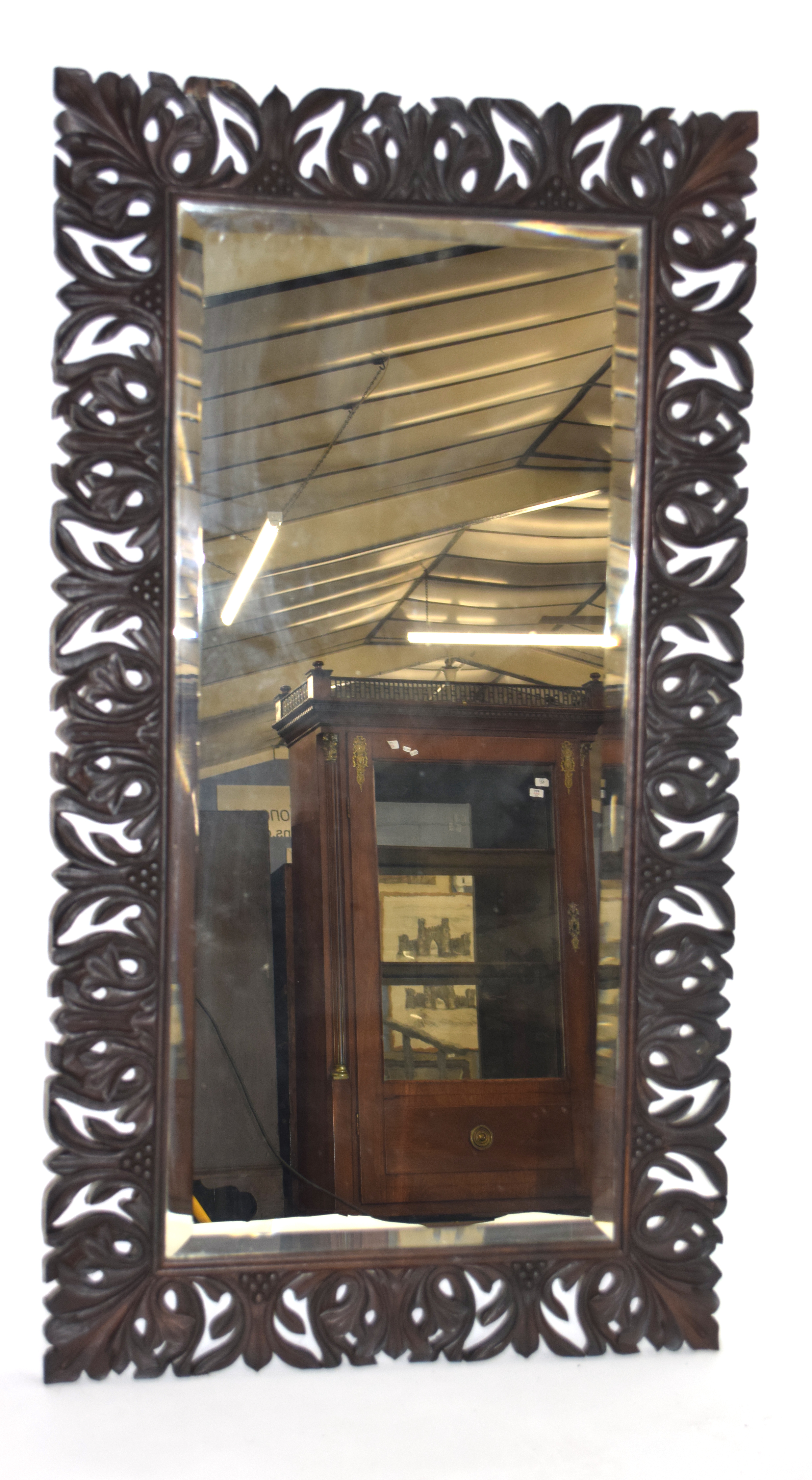 Early 20th century bevelled wall mirror set in a foliate carved frame, inscription to the reverse, - Image 4 of 4