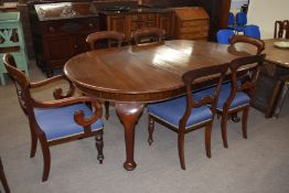 Set of six Victorian mahogany bar back dining chairs comprising two carvers with scrolled arms and
