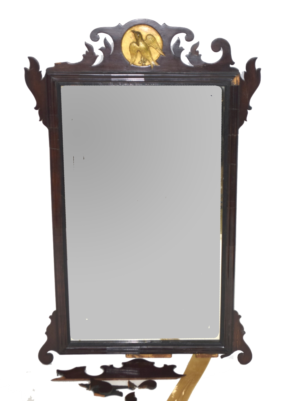 19th century wall mirror in mahogany fret work frame with central gilded roundel detail with bird,