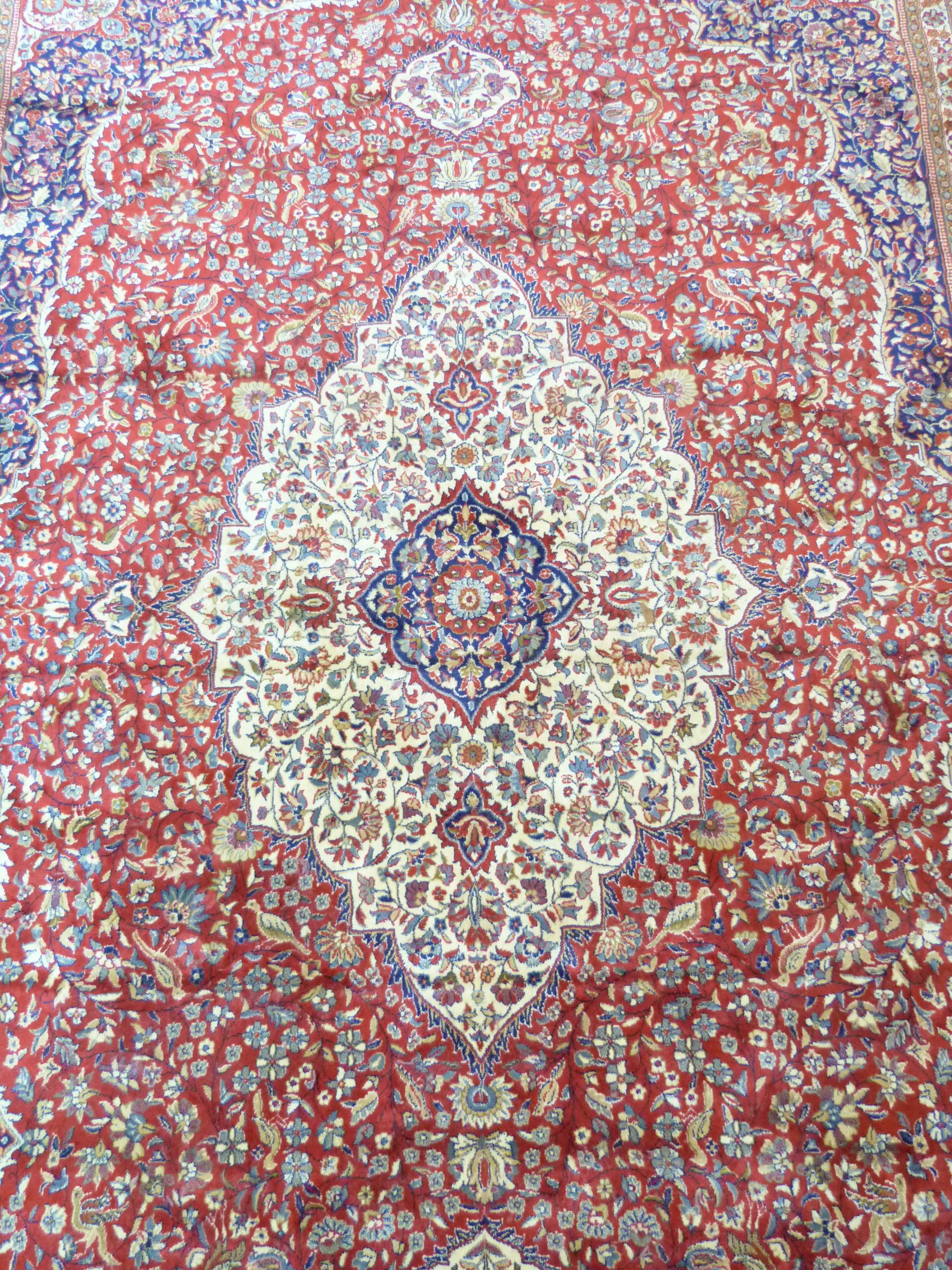 Large red ground full-pile Kashmir Carpet, floral medallion design, 340cm x 230 cm approx - Image 6 of 8