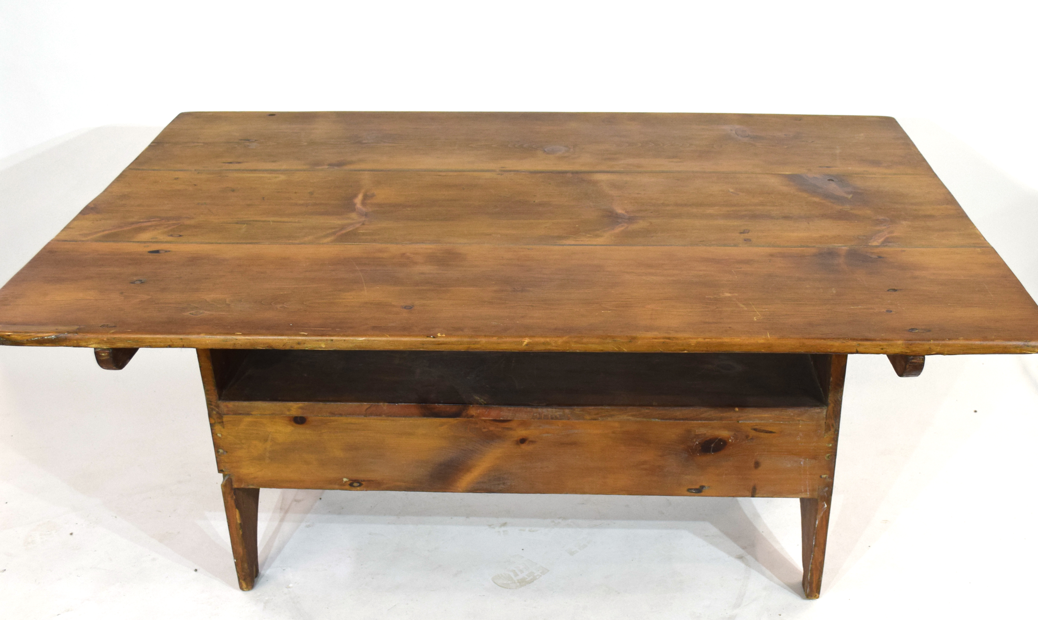 Unusual 20th century stained pine kitchen table, the rectangular top with pegged attachment to a