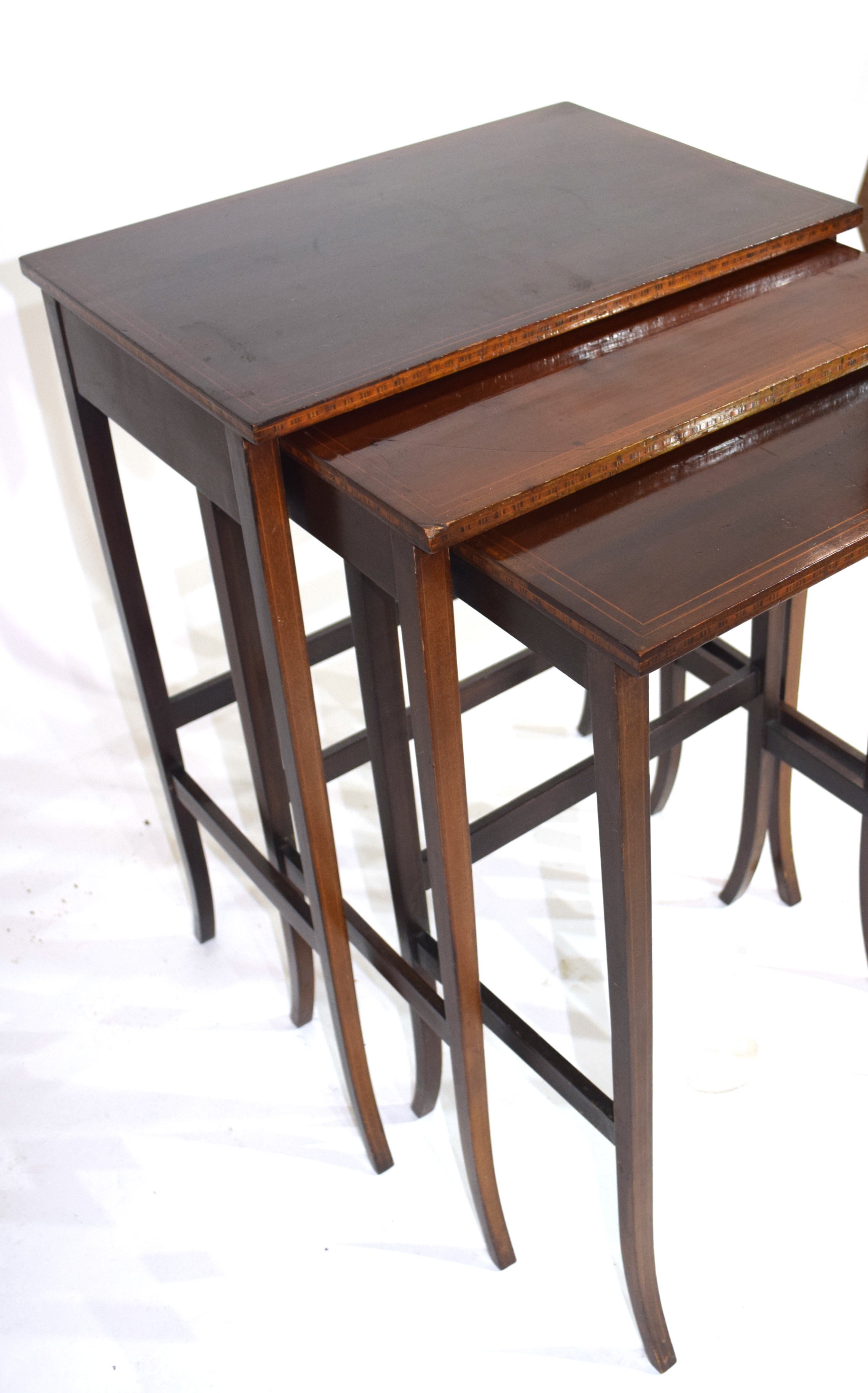 Nest of three Edwardian mahogany and inlaid occasional tables on slender legs, largest 49.5cm wide - Image 5 of 5