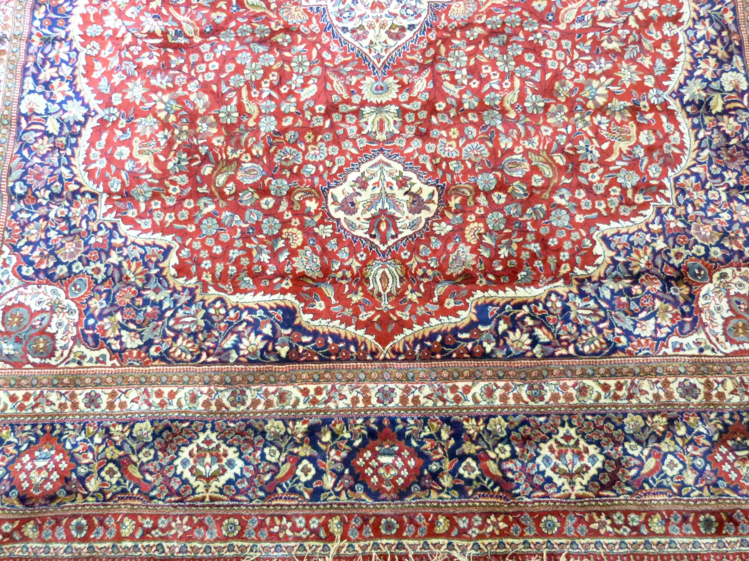 Large red ground full-pile Kashmir Carpet, floral medallion design, 340cm x 230 cm approx - Image 4 of 8