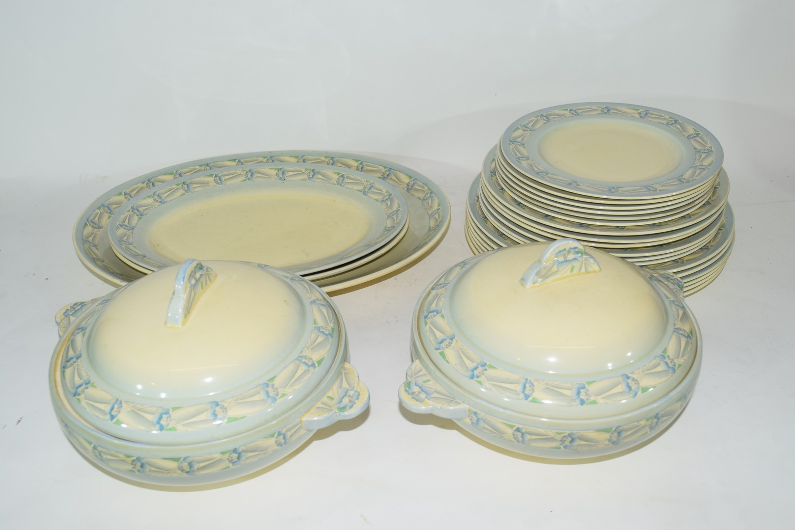 Clarice Cliff Newport pottery part dinner service comprising, two vegetable tureens, two oval meat