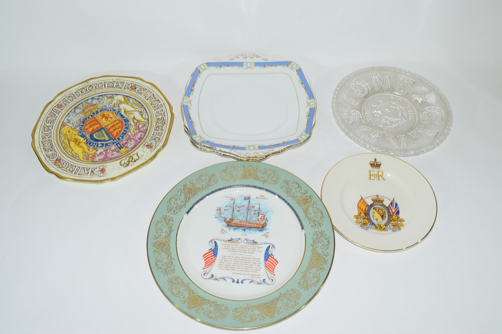 Group of decorative plates including a Paragon commemorative plate