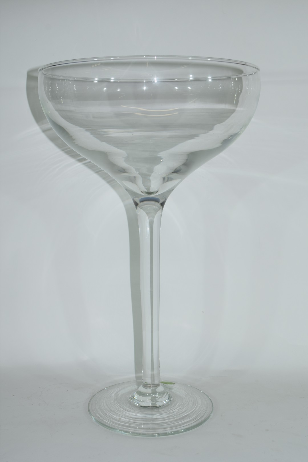 Large clear glass bowl raised on plain stem and foot