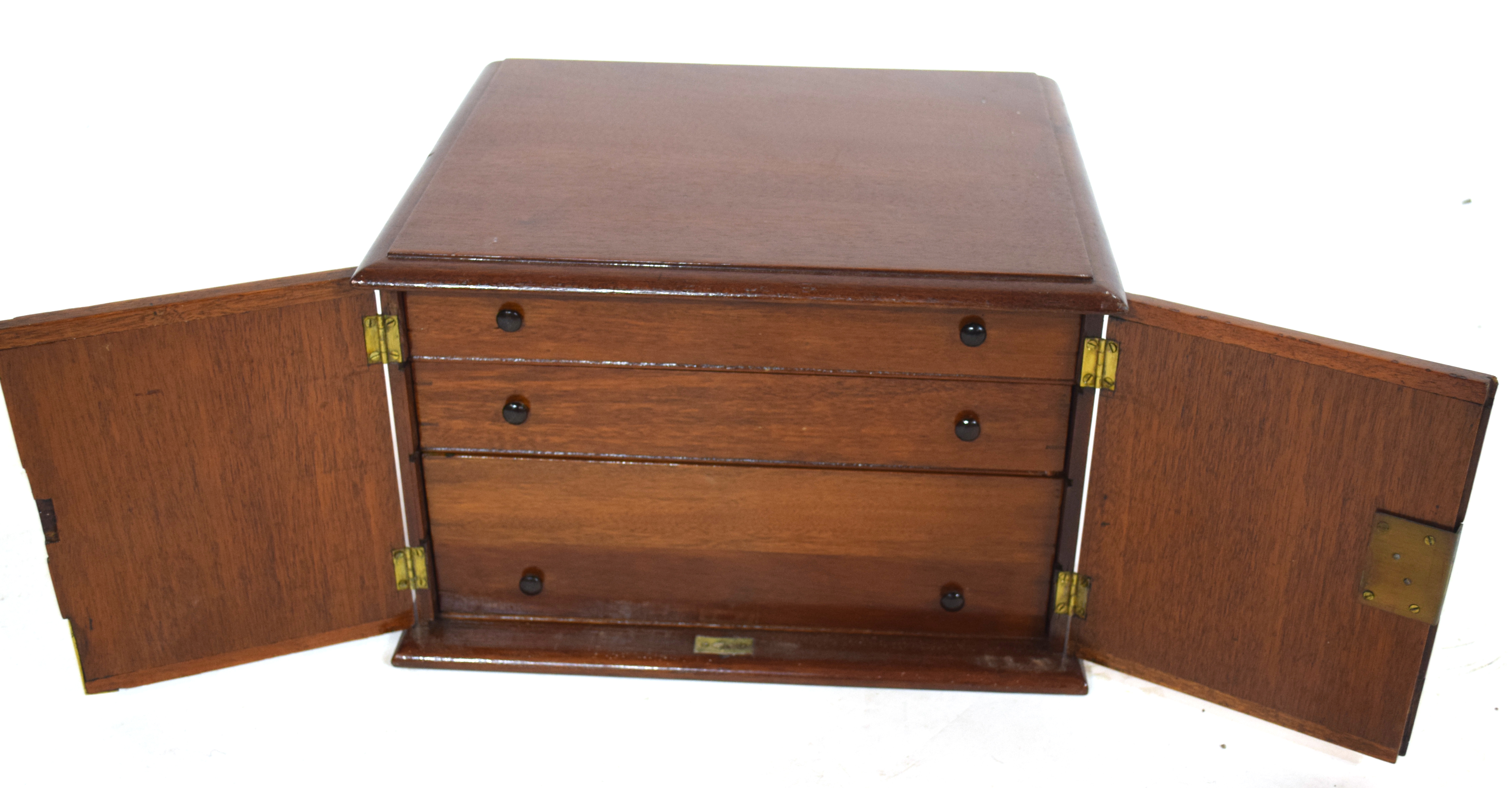 Late 19th/early 20th century hardwood table top cabinet with two doors opening to an interior with - Image 2 of 3