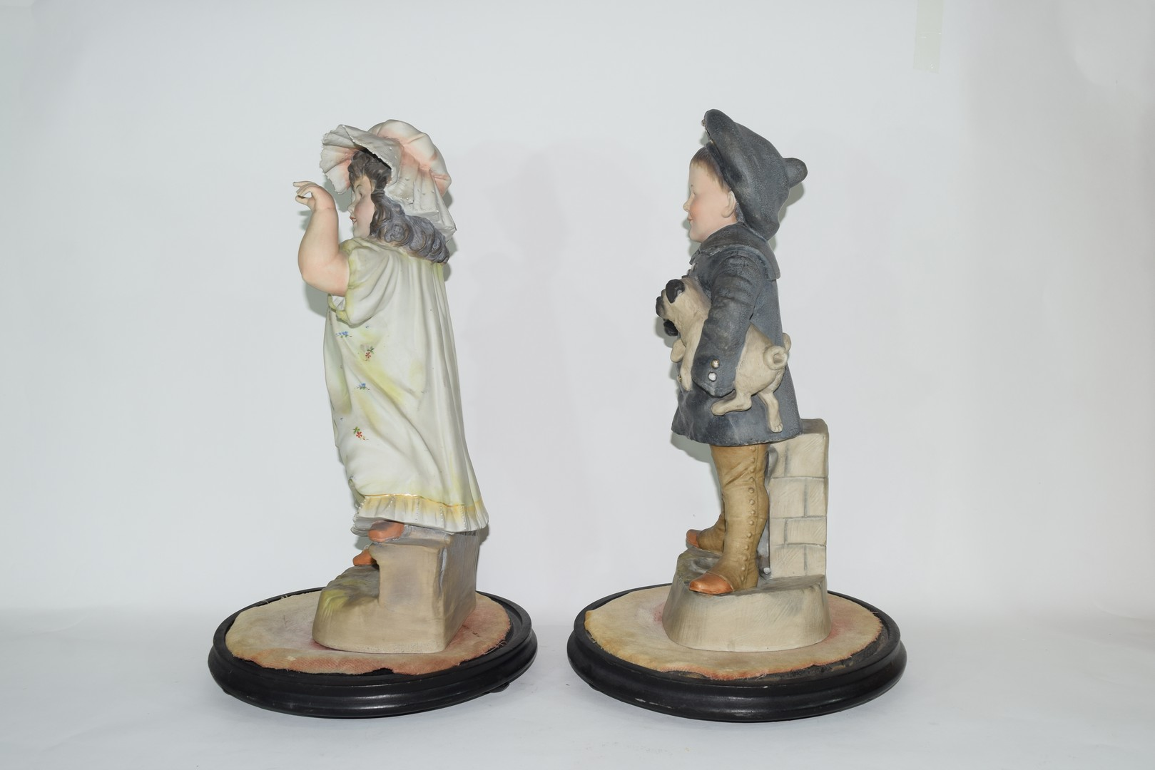 Pair of late 19th century Continental bisque figures of a boy and girl - Image 2 of 4