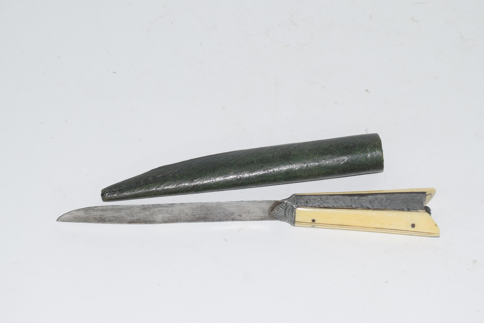 Knife with bone handle in leather sheath