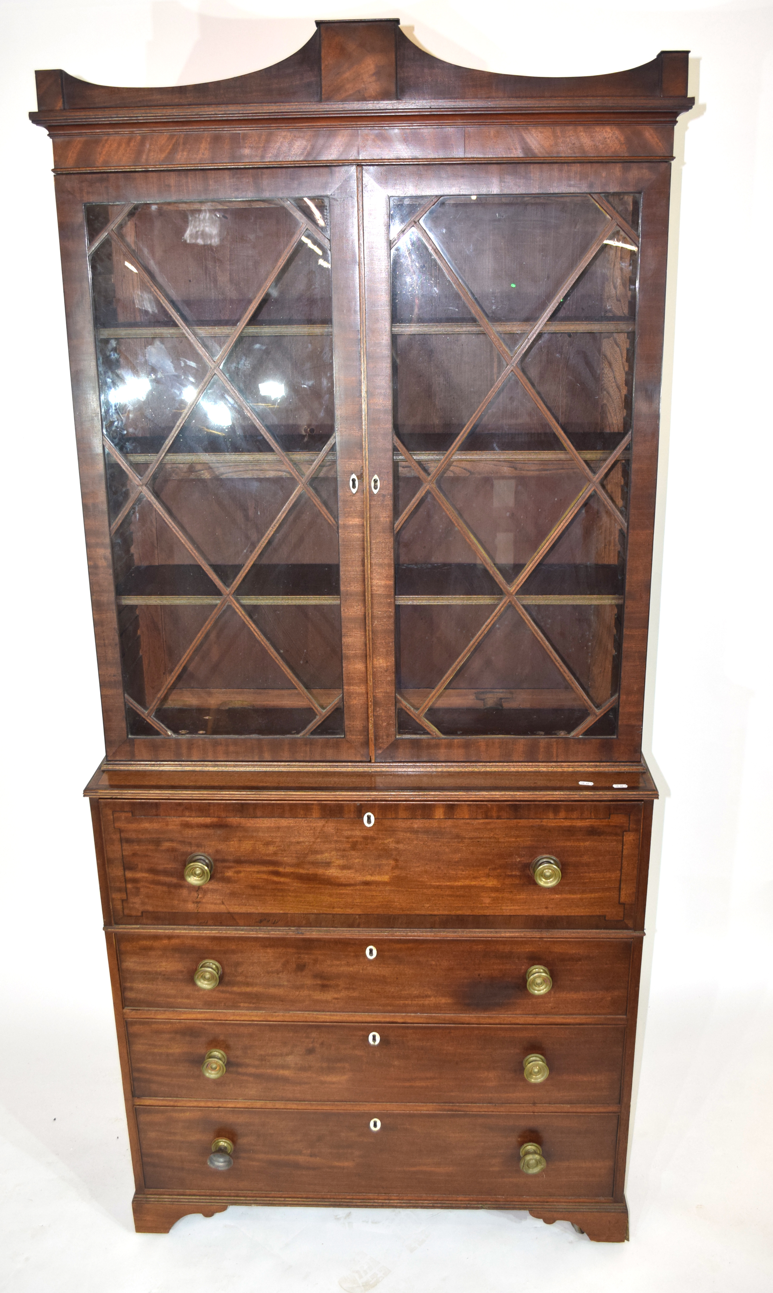 Georgian mahogany secretaire cabinet, top section with a shaped cornice over astragal glazed doors