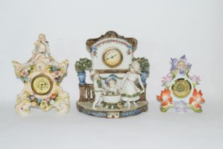 Three examples of Continental porcelain clock mantel cases