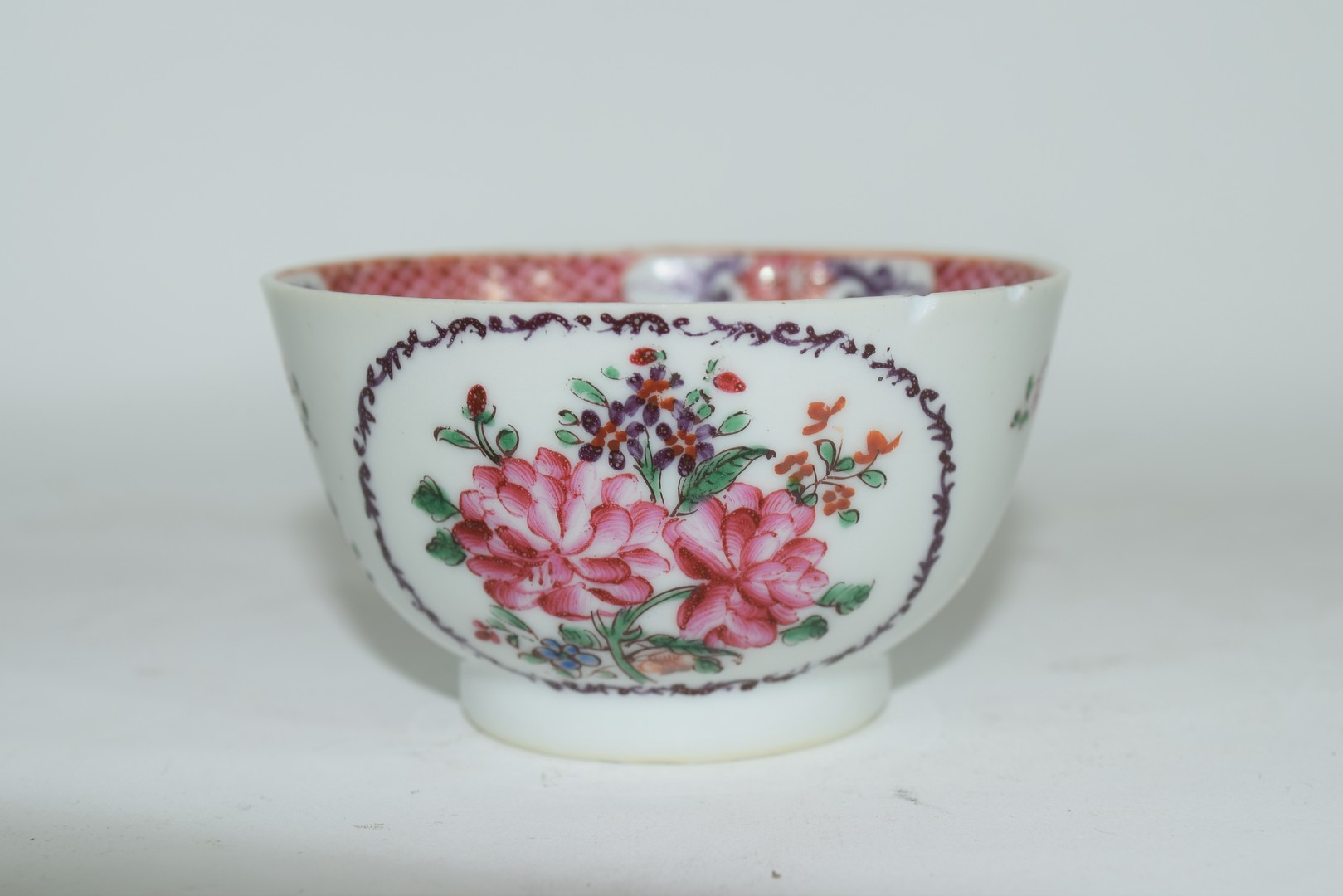Continental porcelain cup and saucer decorated in Meissen style