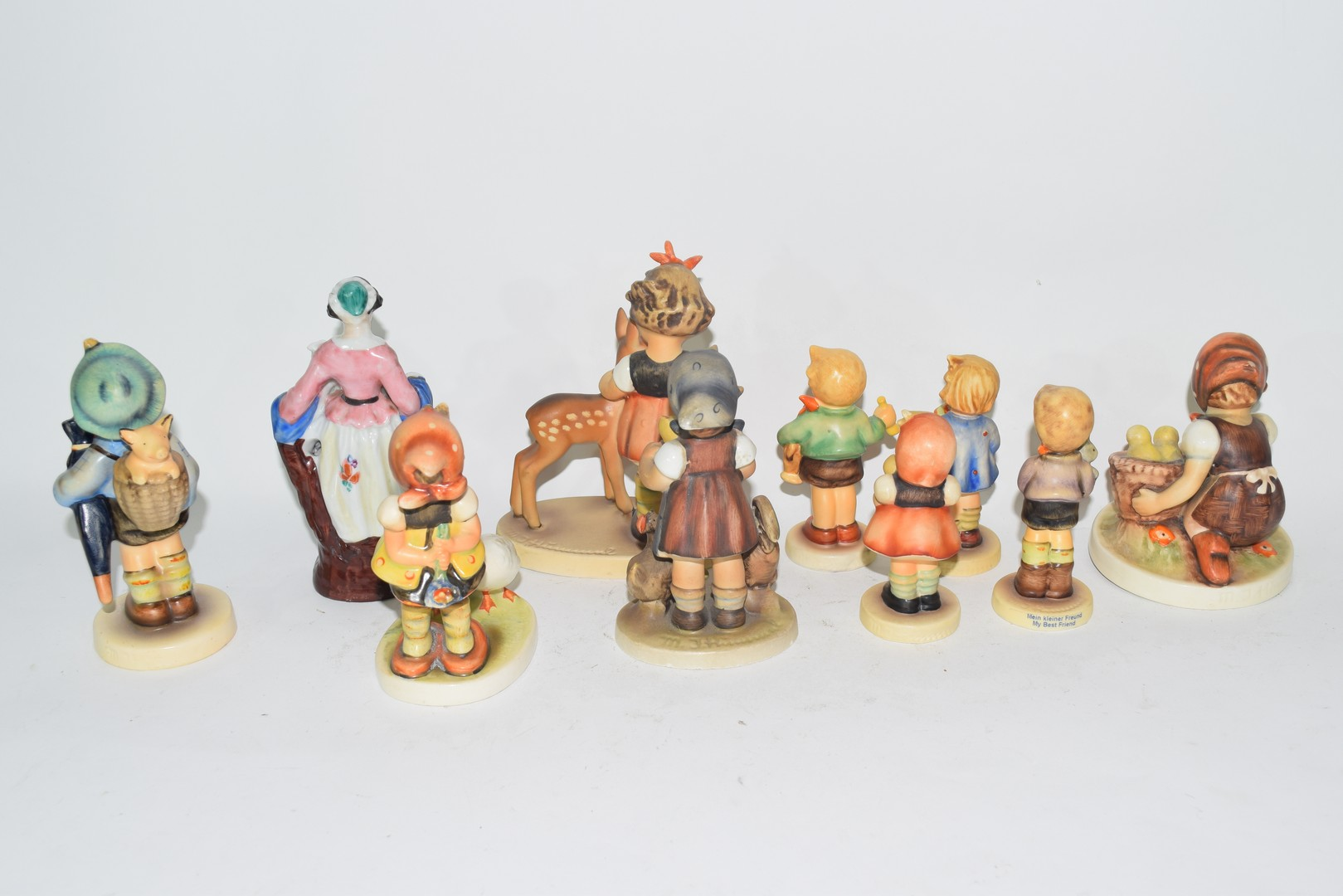 Collection of nine various Goebel/Hummel models of children and a further porcelain figure of a lady - Image 2 of 3
