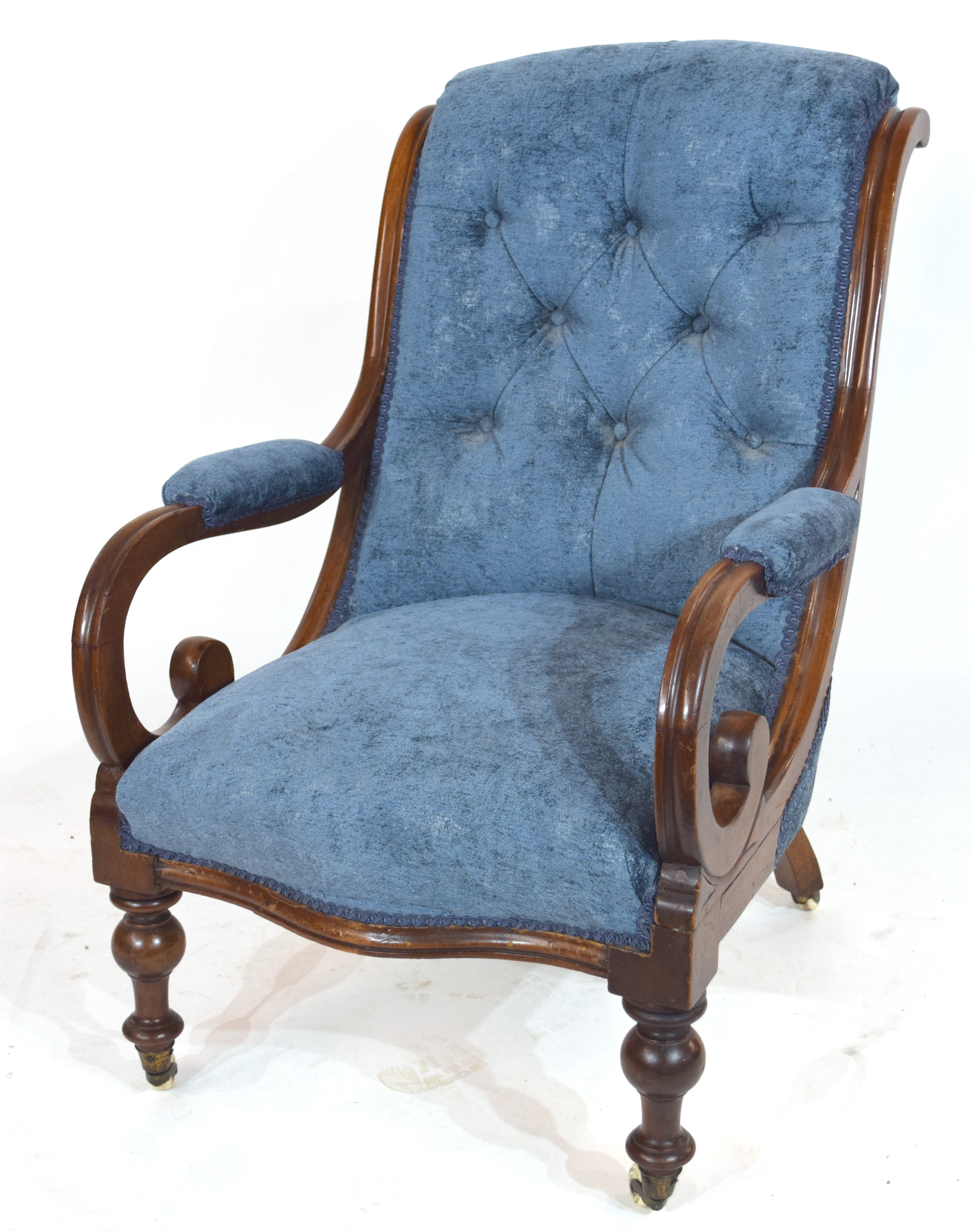 Victorian mahogany framed armchair with show wood frame, scrolled arms and turned front legs with