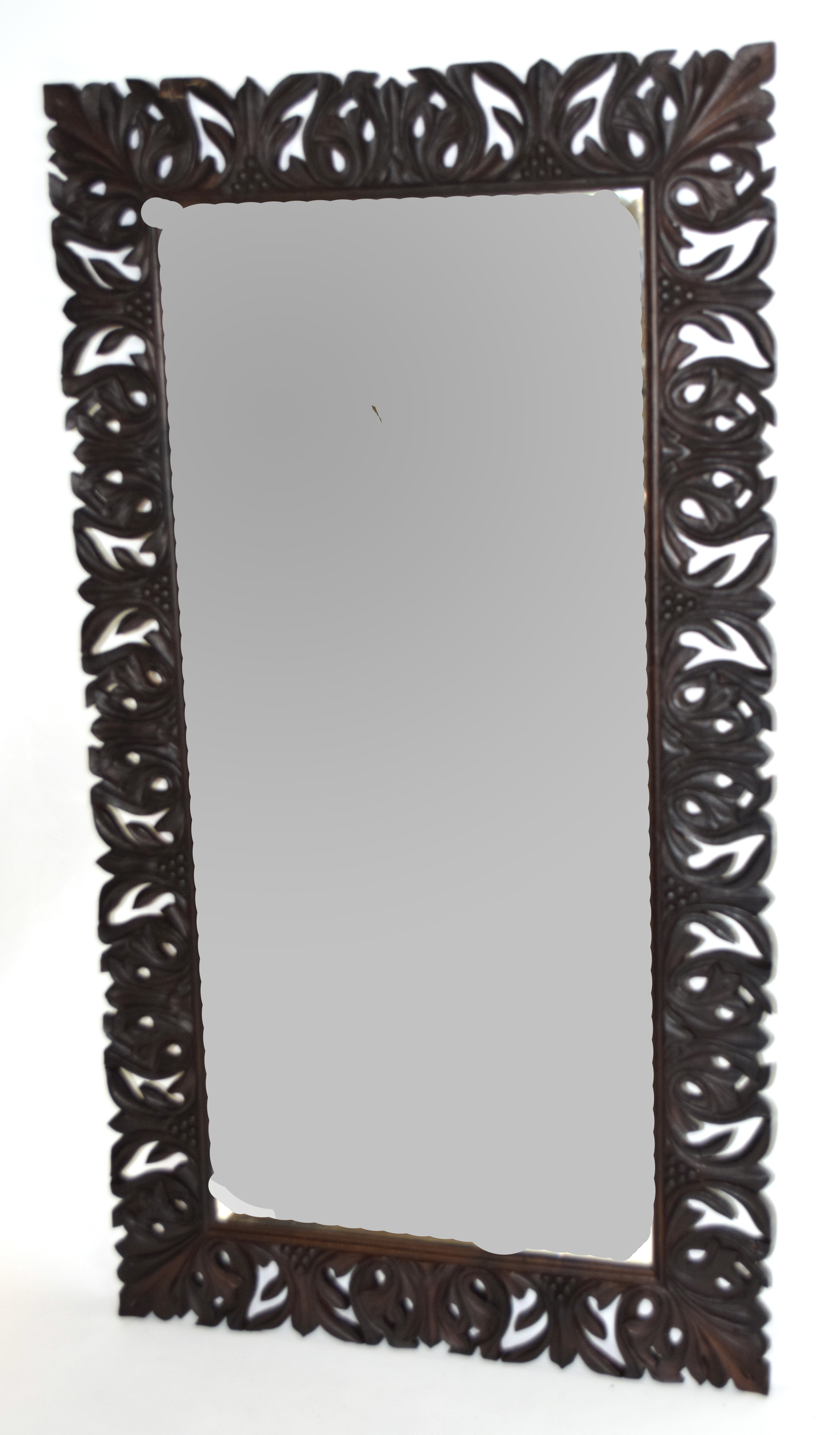 Early 20th century bevelled wall mirror set in a foliate carved frame, inscription to the reverse,