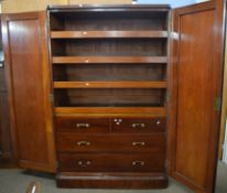 Victorian mahogany linen press cabinet with two large panelled doors opening to an interior with