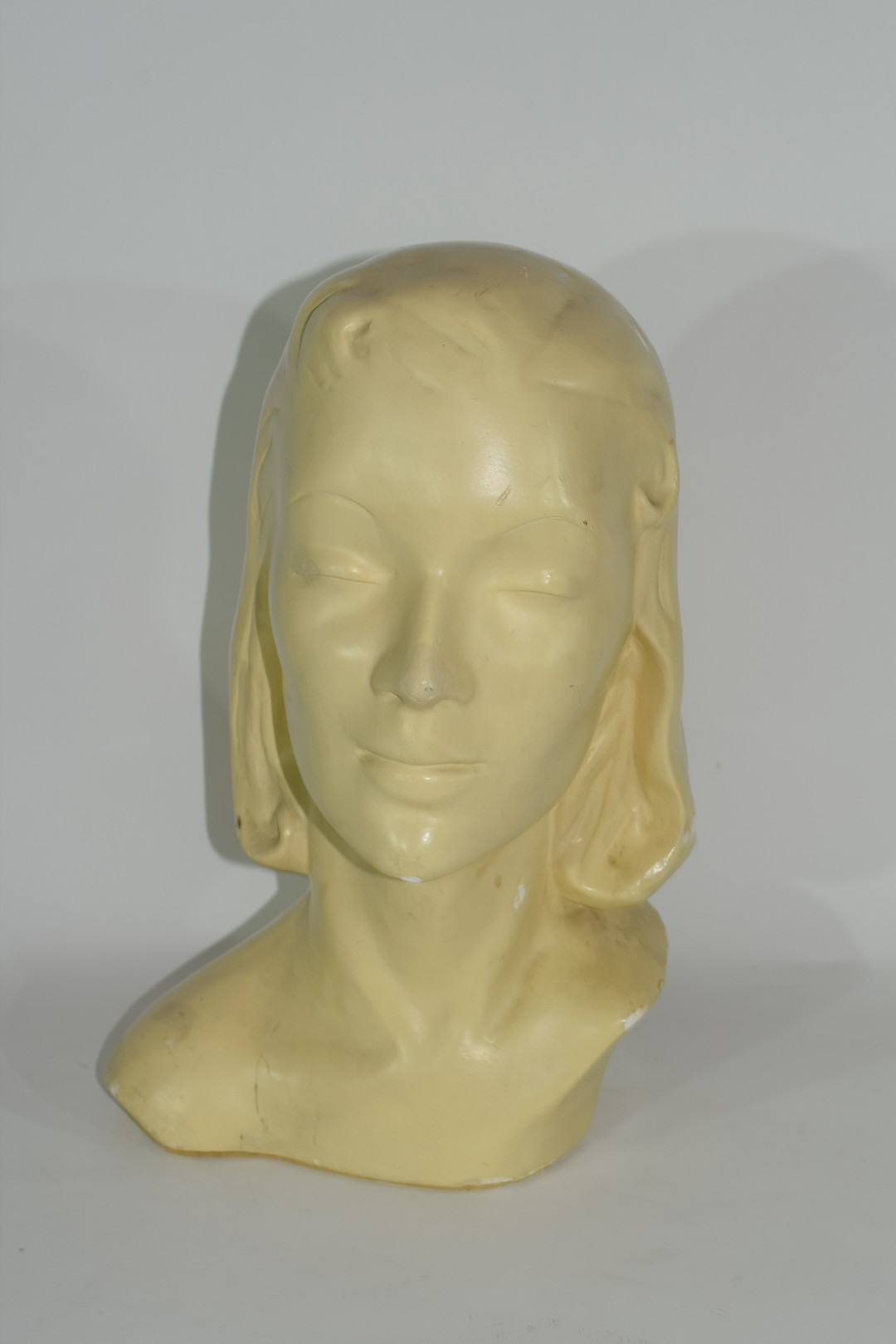 Plaster Art Deco bust of the head and shoulders of a young girl