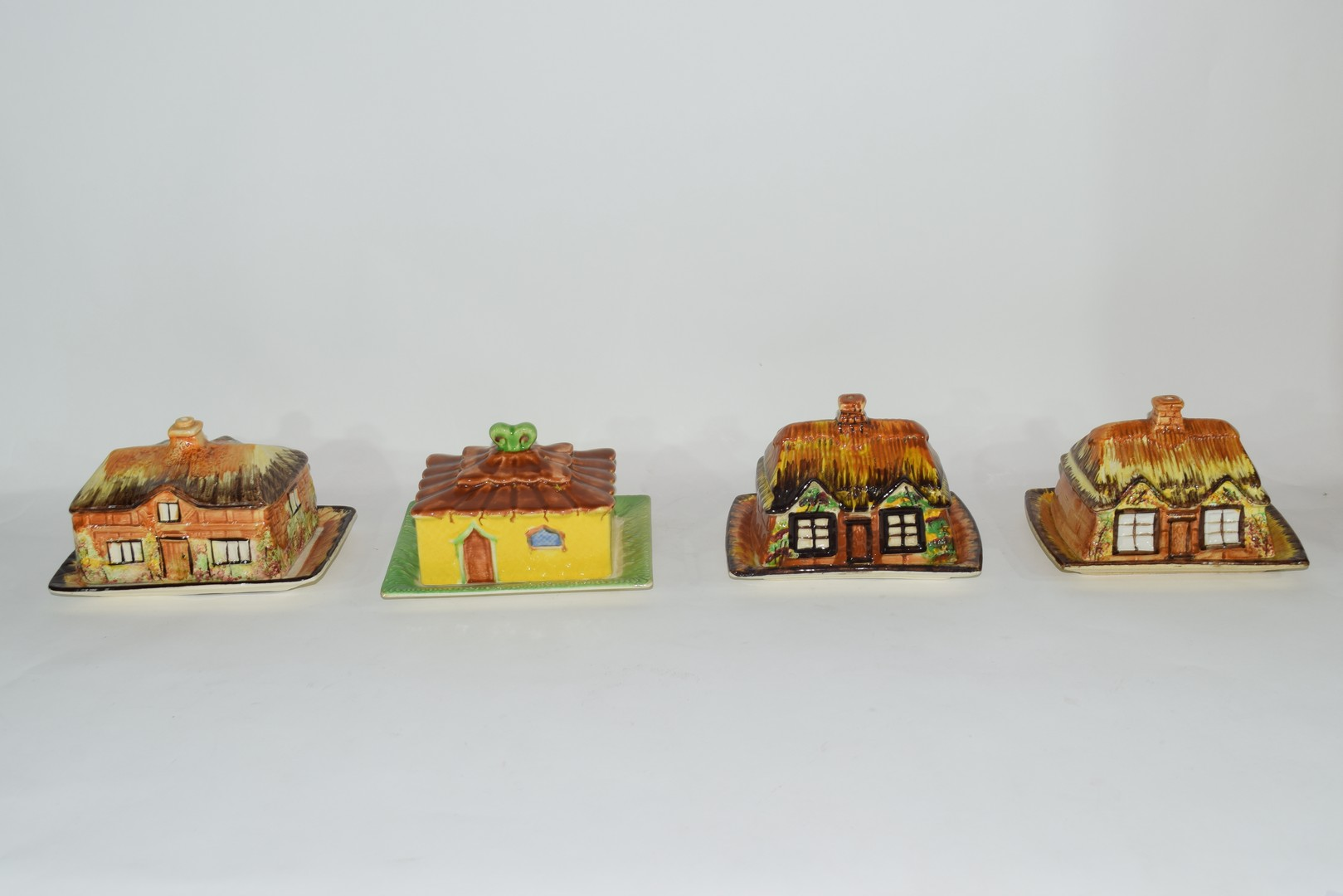 Group of mid-20th century cottage style cheese dish and butter dishes