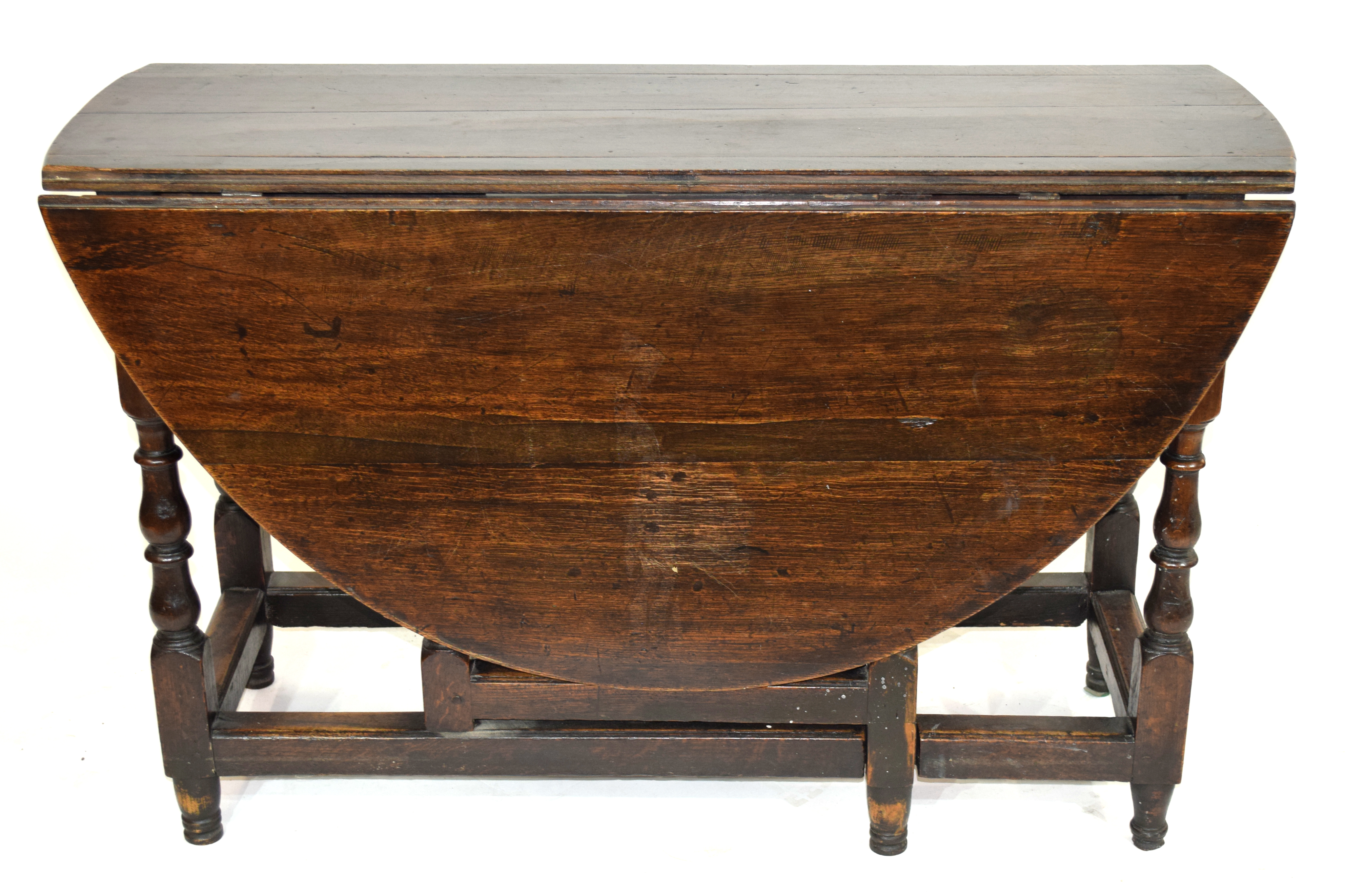 18th century oval oak gateleg table raised on turned legs, 120cm wide Condition: Overall surface