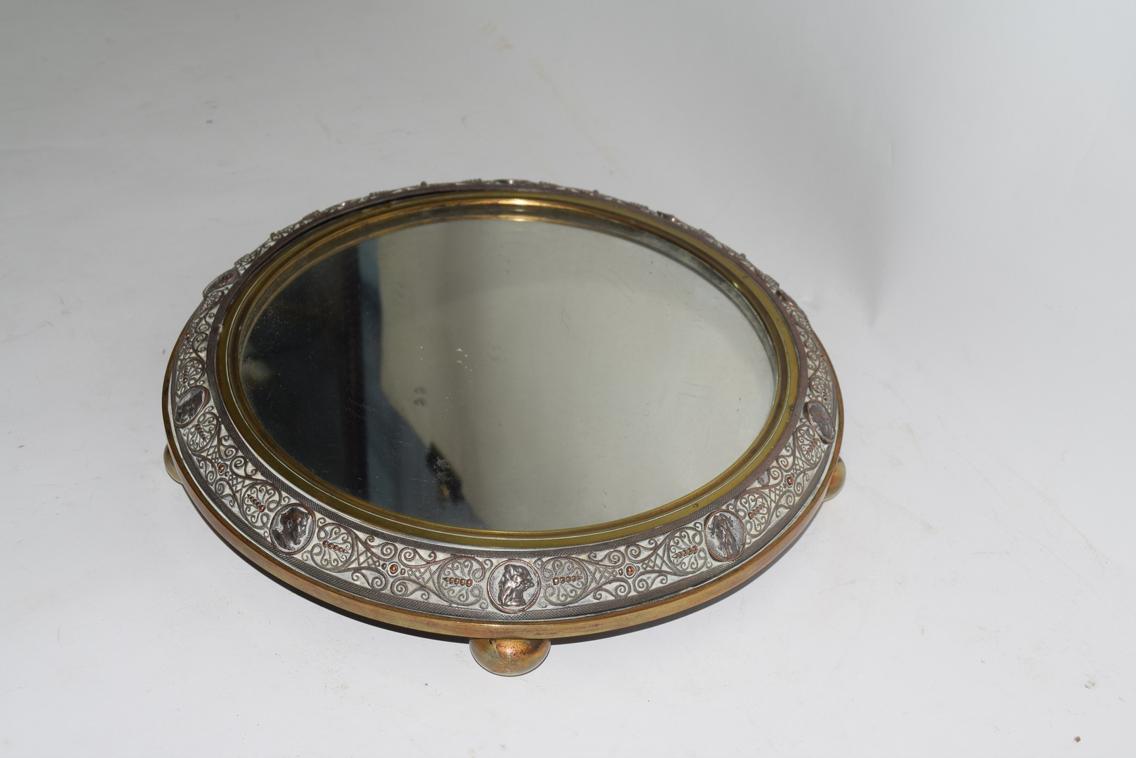 Victorian copper and brass mounted circular mirrored table stand decorated with figural and - Image 5 of 6