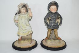 Pair of late 19th century Continental bisque figures of a boy and girl