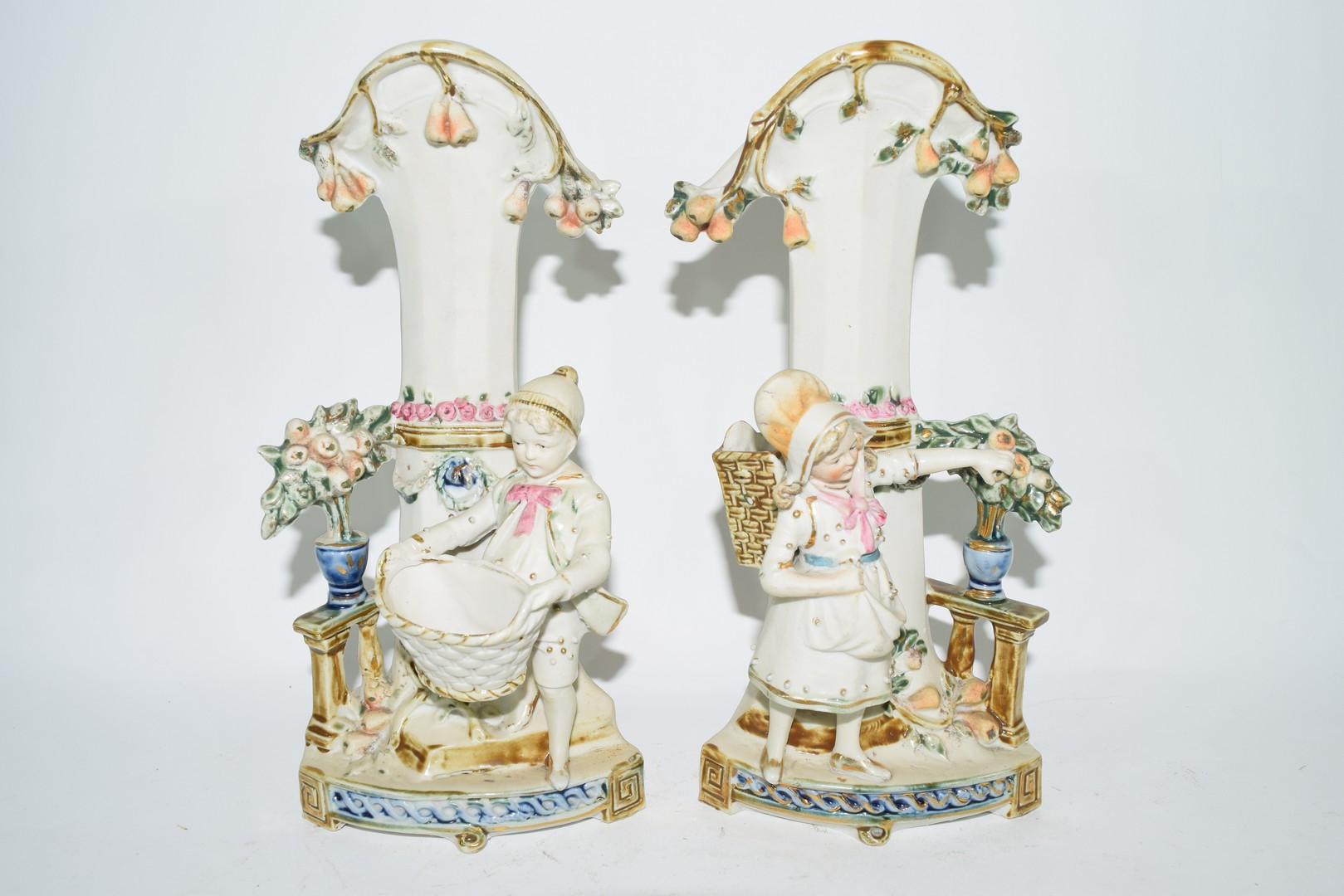Pair of bisque porcelain spill holder vases