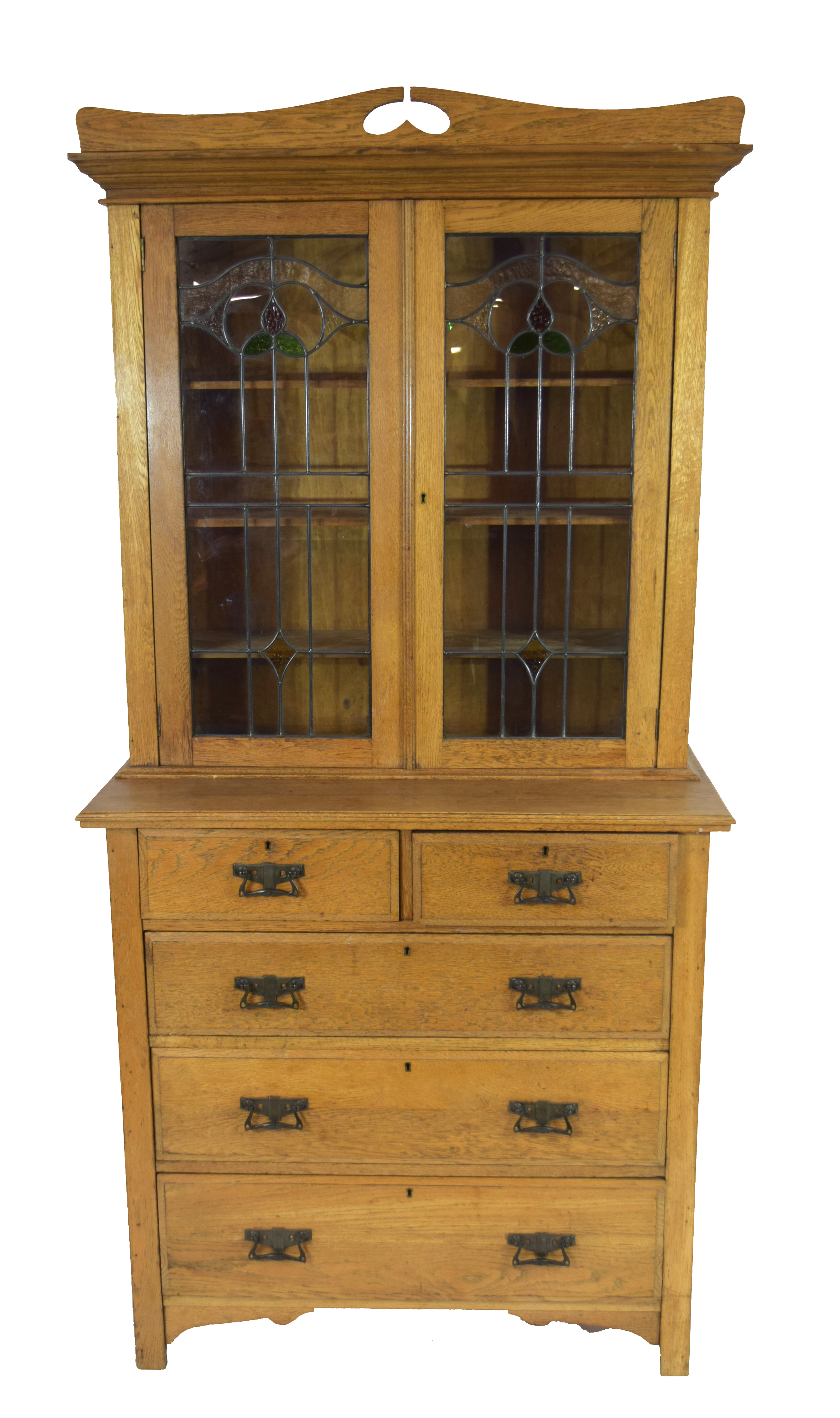 Late 19th century light oak two-piece cabinet, the top section with double glazed doors with Art