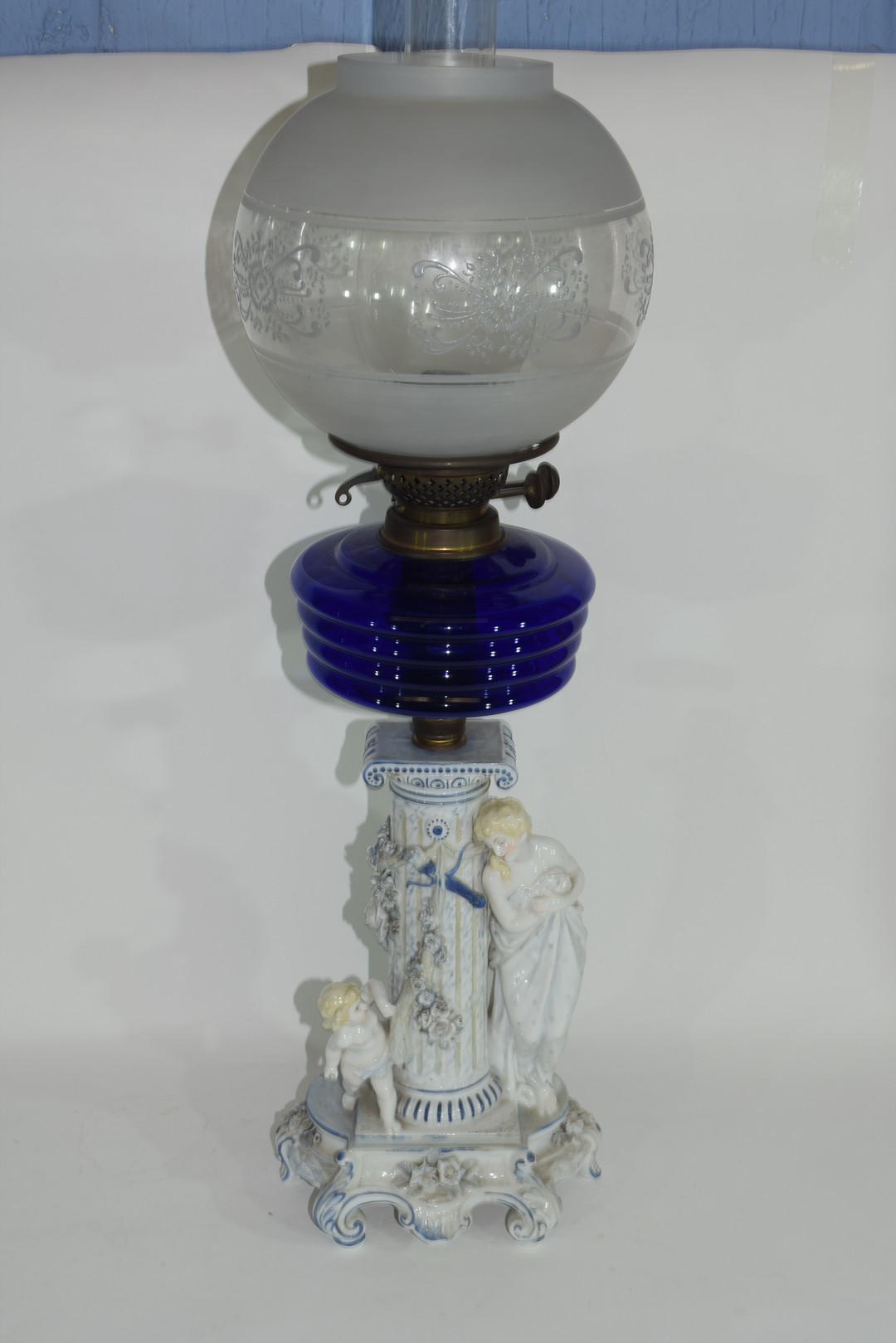 Oil lamp with blue glass reservoir
