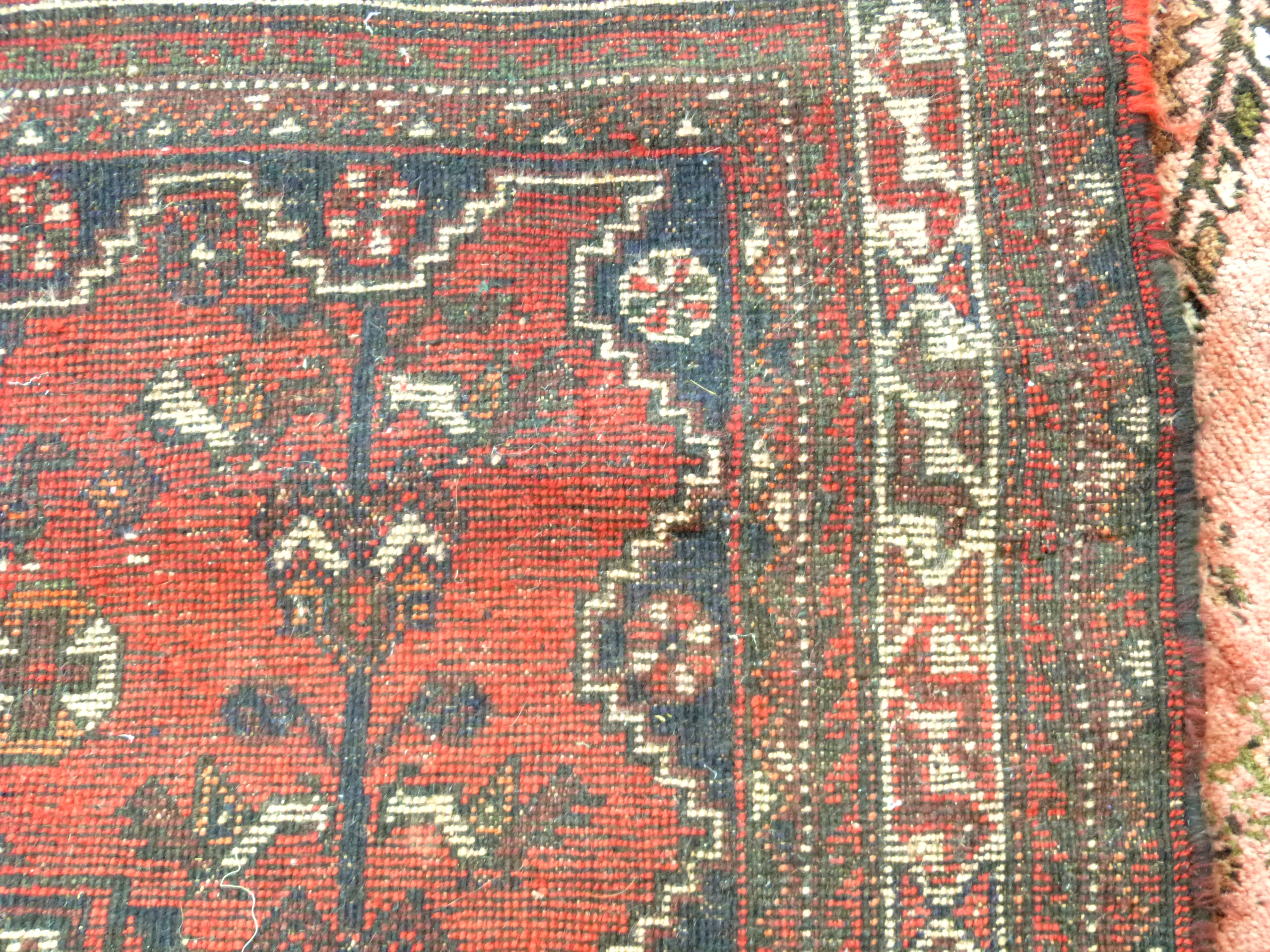 Caucasian wool carpet with three large lozenges to centre, in faded beige, red and pink, 173 x - Image 5 of 6