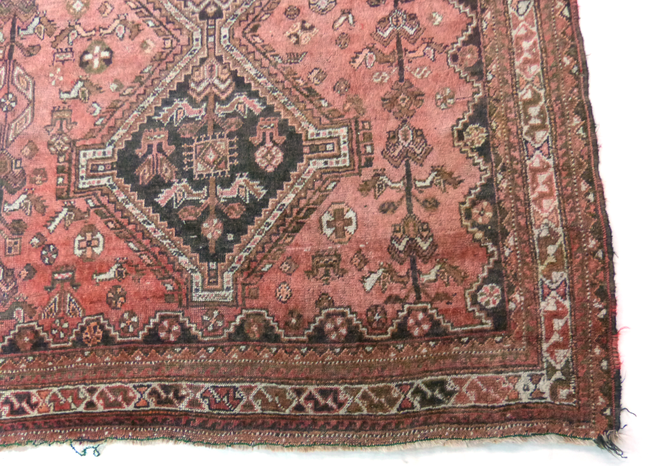 Caucasian wool carpet with three large lozenges to centre, in faded beige, red and pink, 173 x - Image 3 of 6