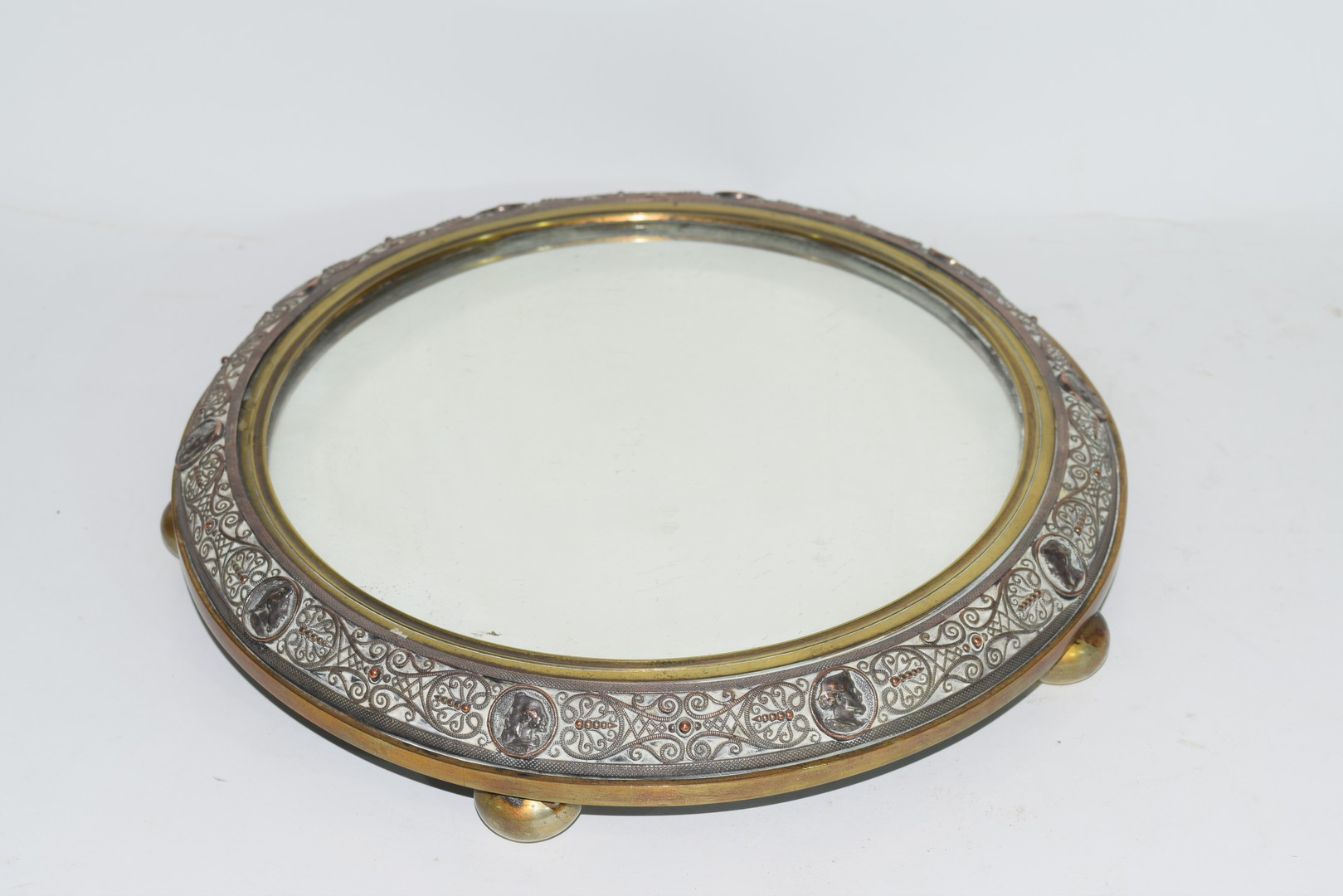 Victorian copper and brass mounted circular mirrored table stand decorated with figural and - Image 3 of 6