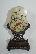 Piece of quartz with floral green decoration