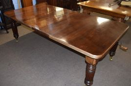 Late Victorian mahogany extending dining table raised on fluted legs and brass casters, 237cm wide