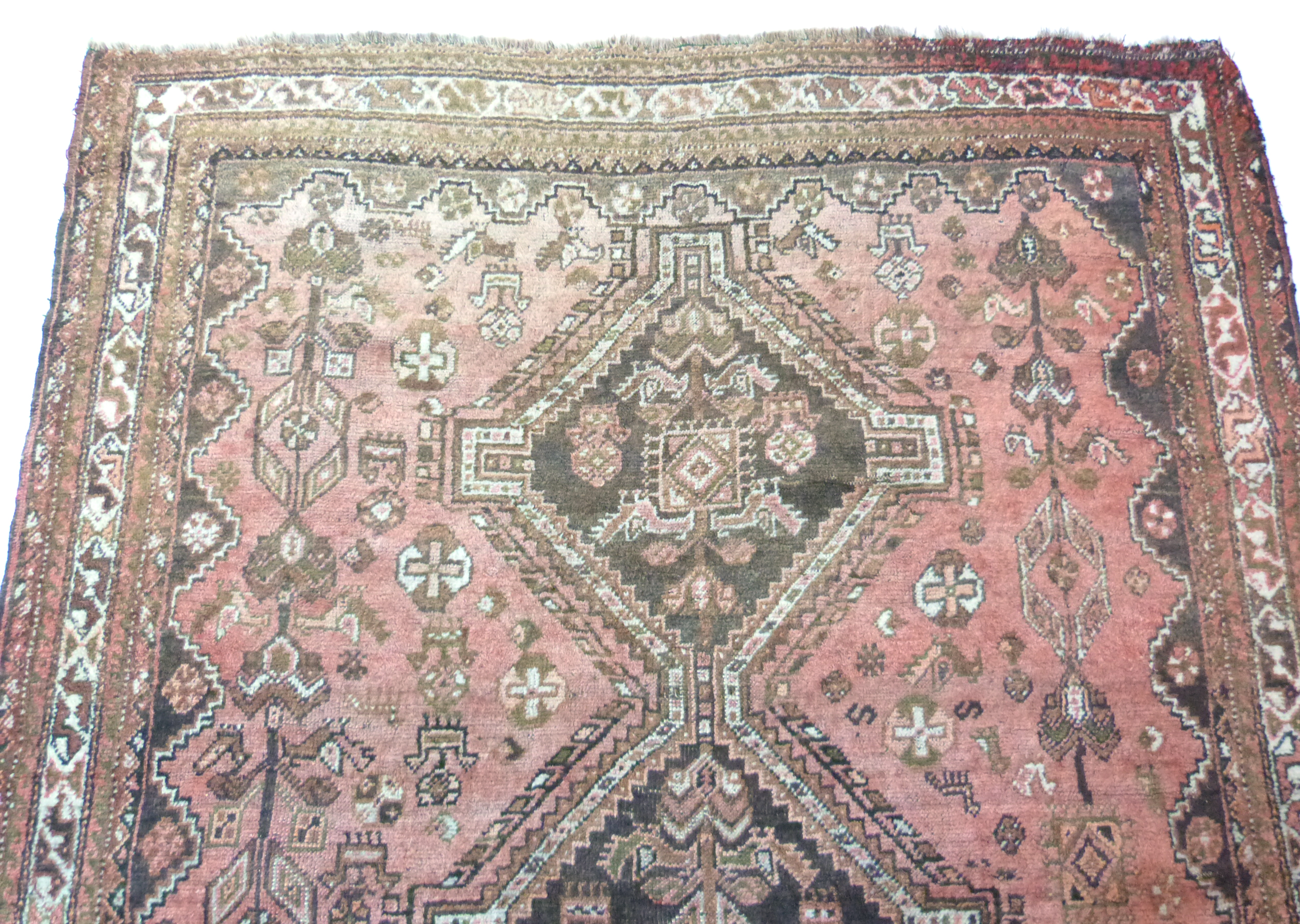 Caucasian wool carpet with three large lozenges to centre, in faded beige, red and pink, 173 x - Image 2 of 6