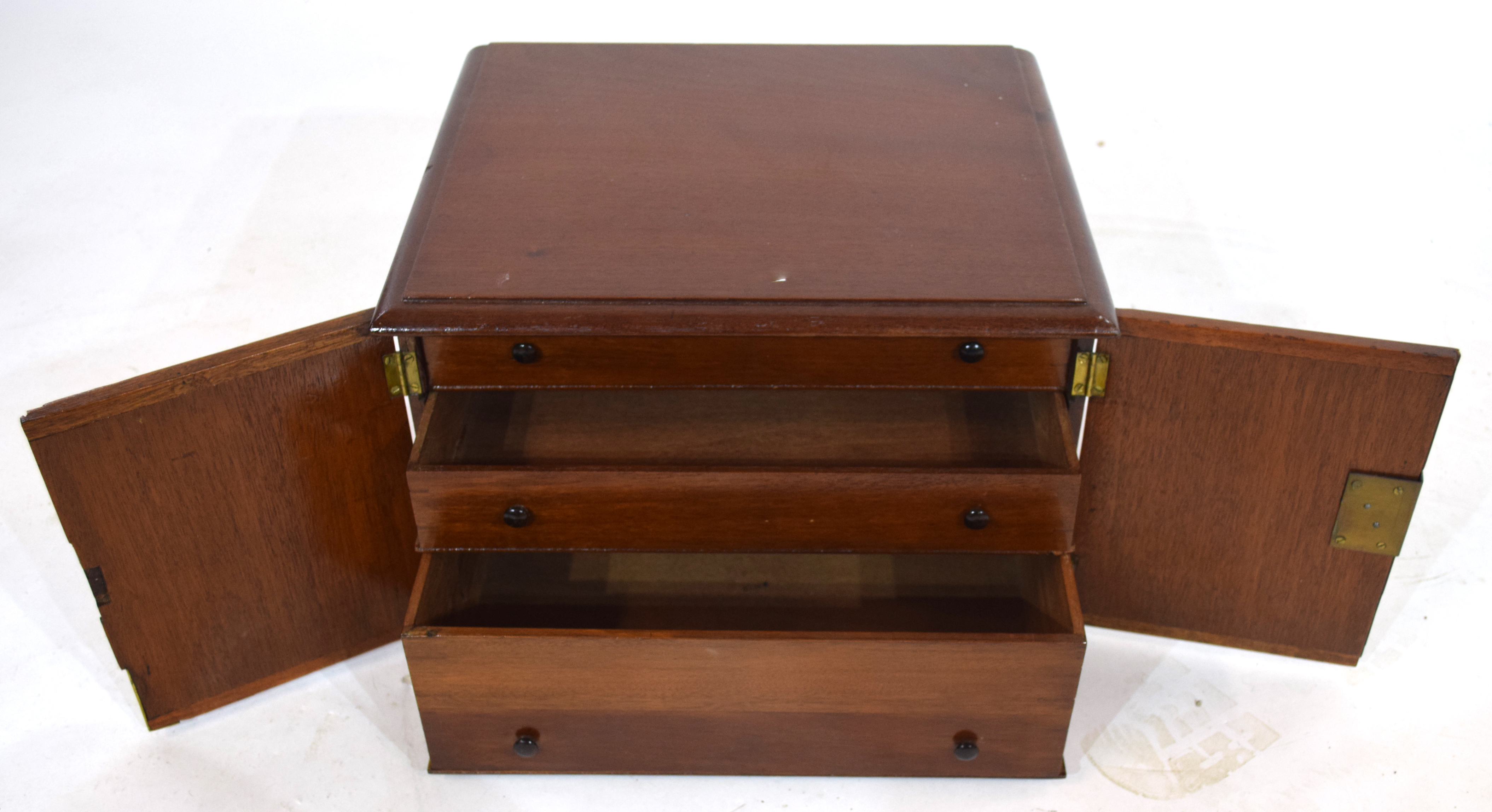 Late 19th/early 20th century hardwood table top cabinet with two doors opening to an interior with - Image 3 of 3