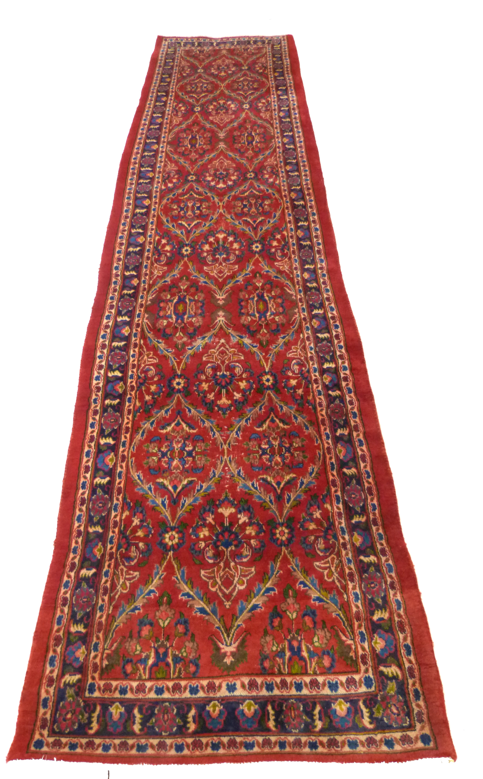 Large red ground Persian Kashan Runner, with all-over floral pattern 397cm x 93cm approximately No