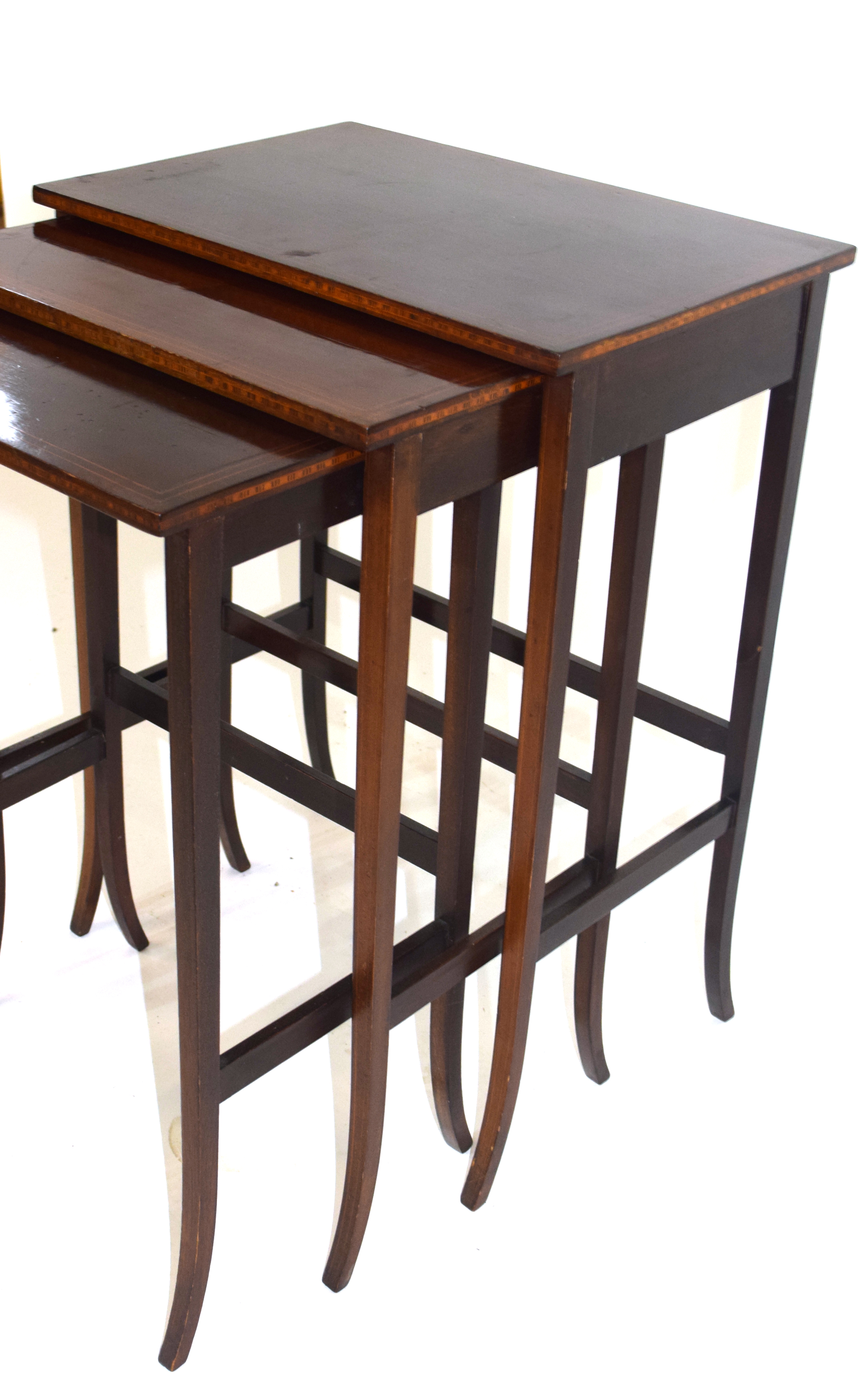 Nest of three Edwardian mahogany and inlaid occasional tables on slender legs, largest 49.5cm wide - Image 4 of 5