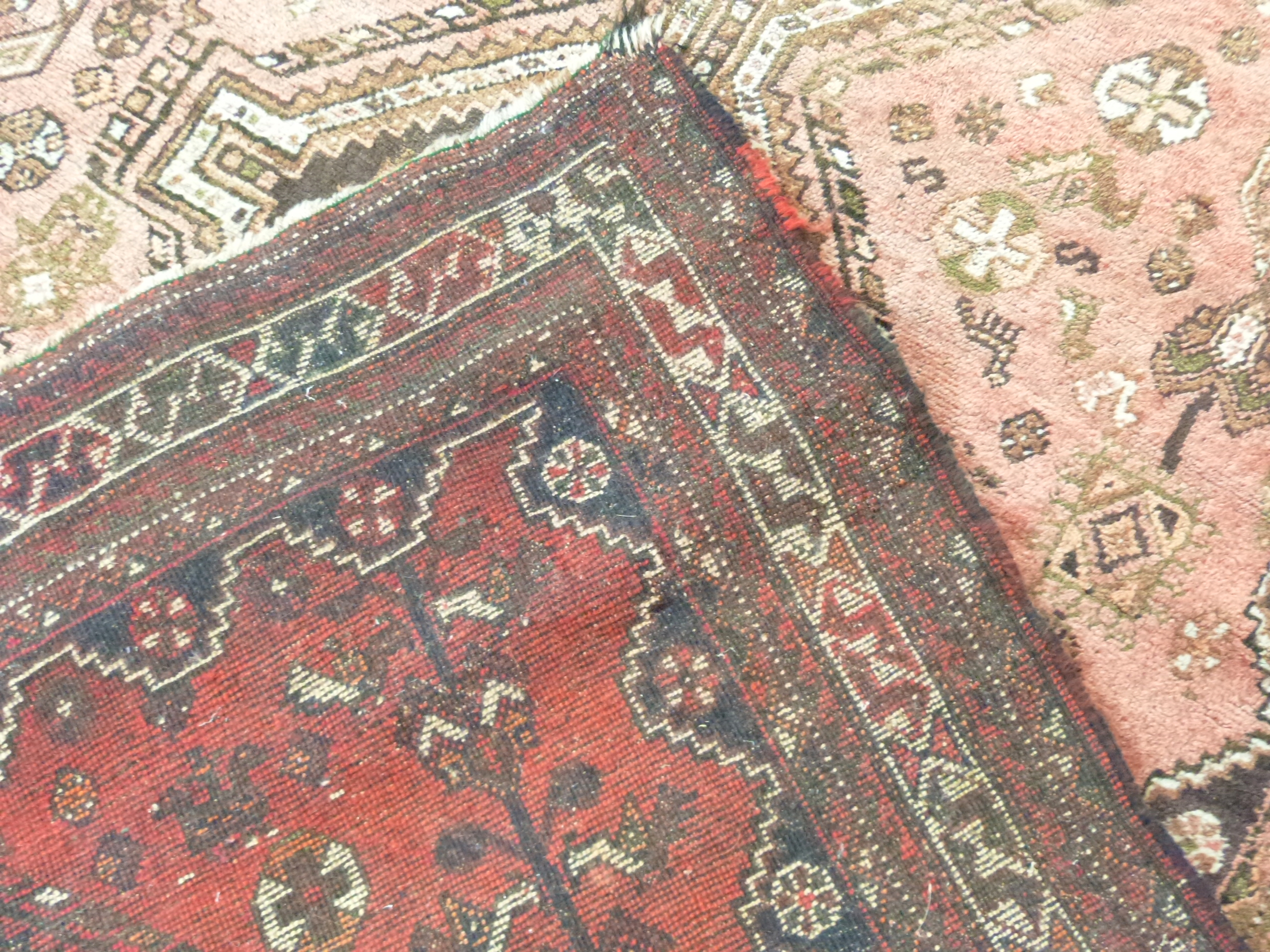 Caucasian wool carpet with three large lozenges to centre, in faded beige, red and pink, 173 x - Image 4 of 6