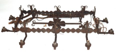 20th century iron ten-branch light fitting, the rectangular centre with floral decoration and