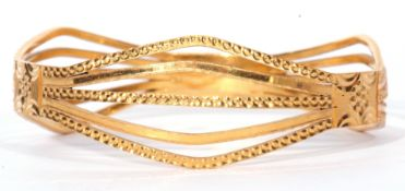 High grade yellow metal stylised openwork bracelet, chased and engraved with a bead design 33.4 gms