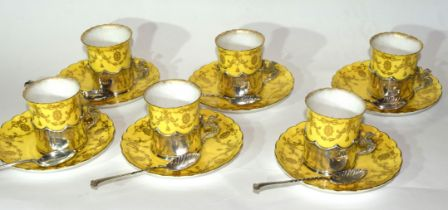 Set of six Royal Worcester coffee cans and saucers, the coffee cans in silver holders with Griffin
