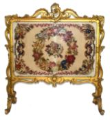 Large gilt gesso framed fire screen, the frame with elaborate foliate and scrolled detail, the